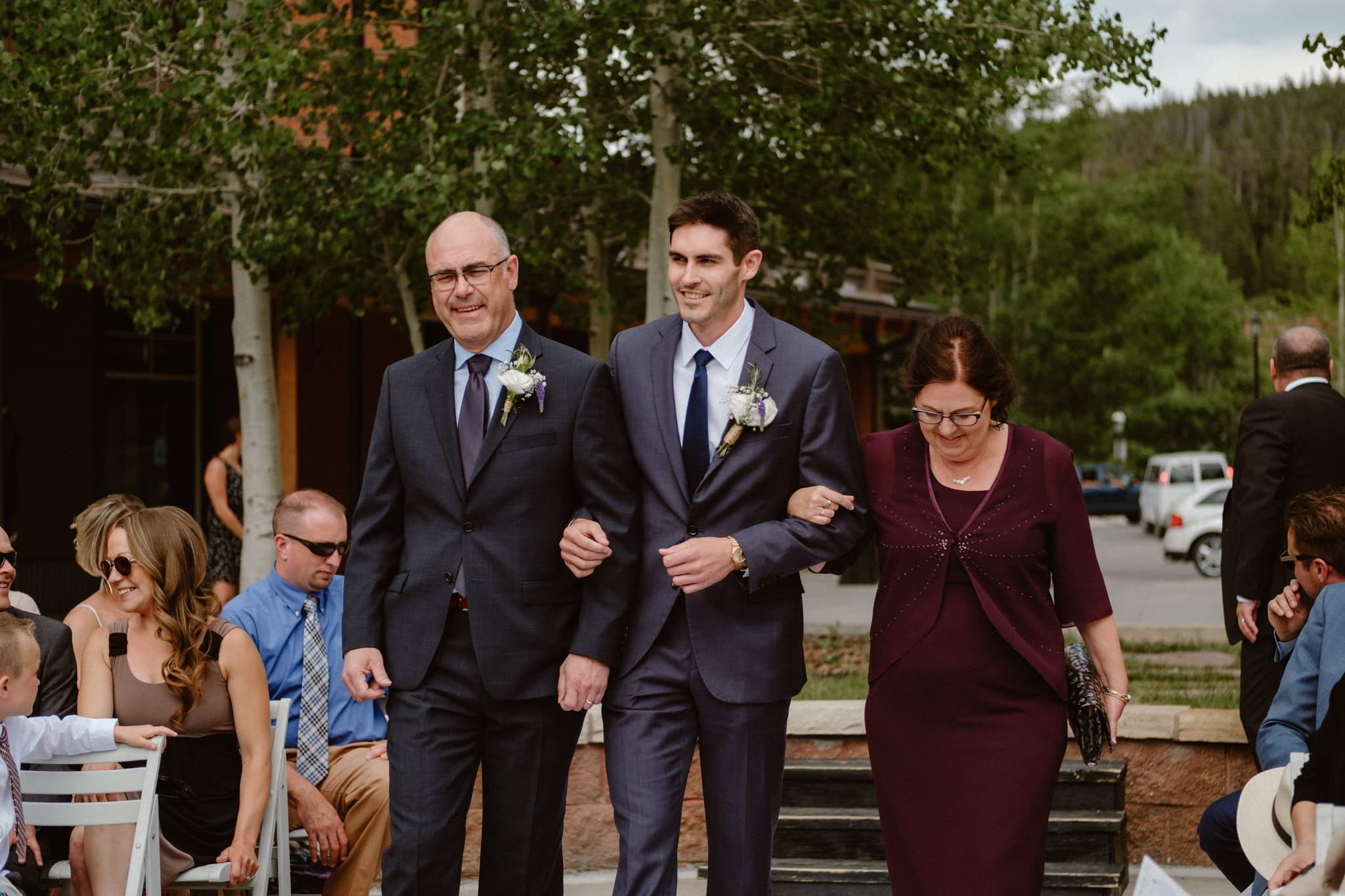 Groom and parents walking down the aisle at Main Street Station wedding, Breckenridge wedding photographer