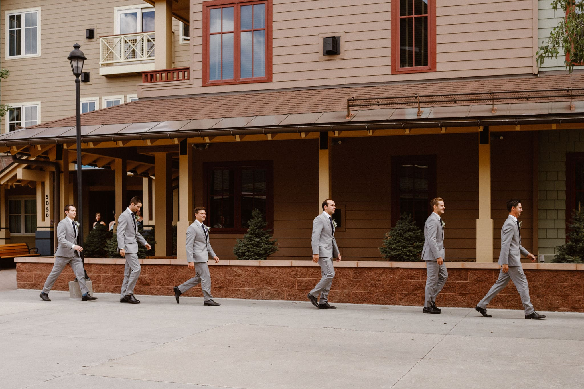 Groomsmen walking down the aisle at Main Street Station wedding, Breckenridge wedding photographer