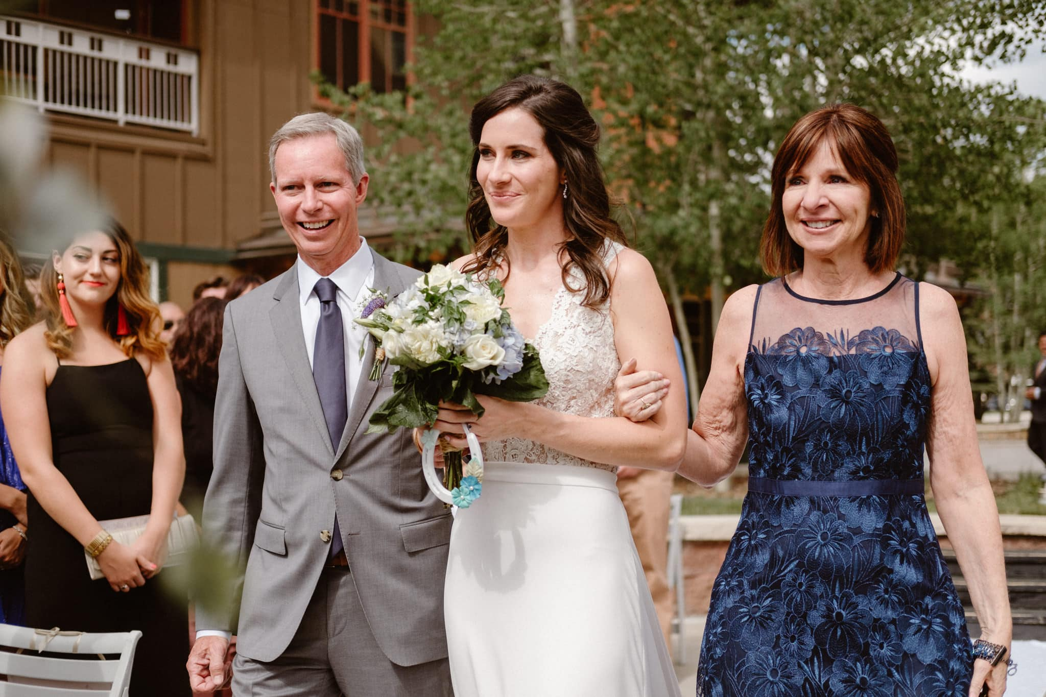 Bride and parents walking down the aisle at Main Street Station wedding, Breckenridge wedding photographer