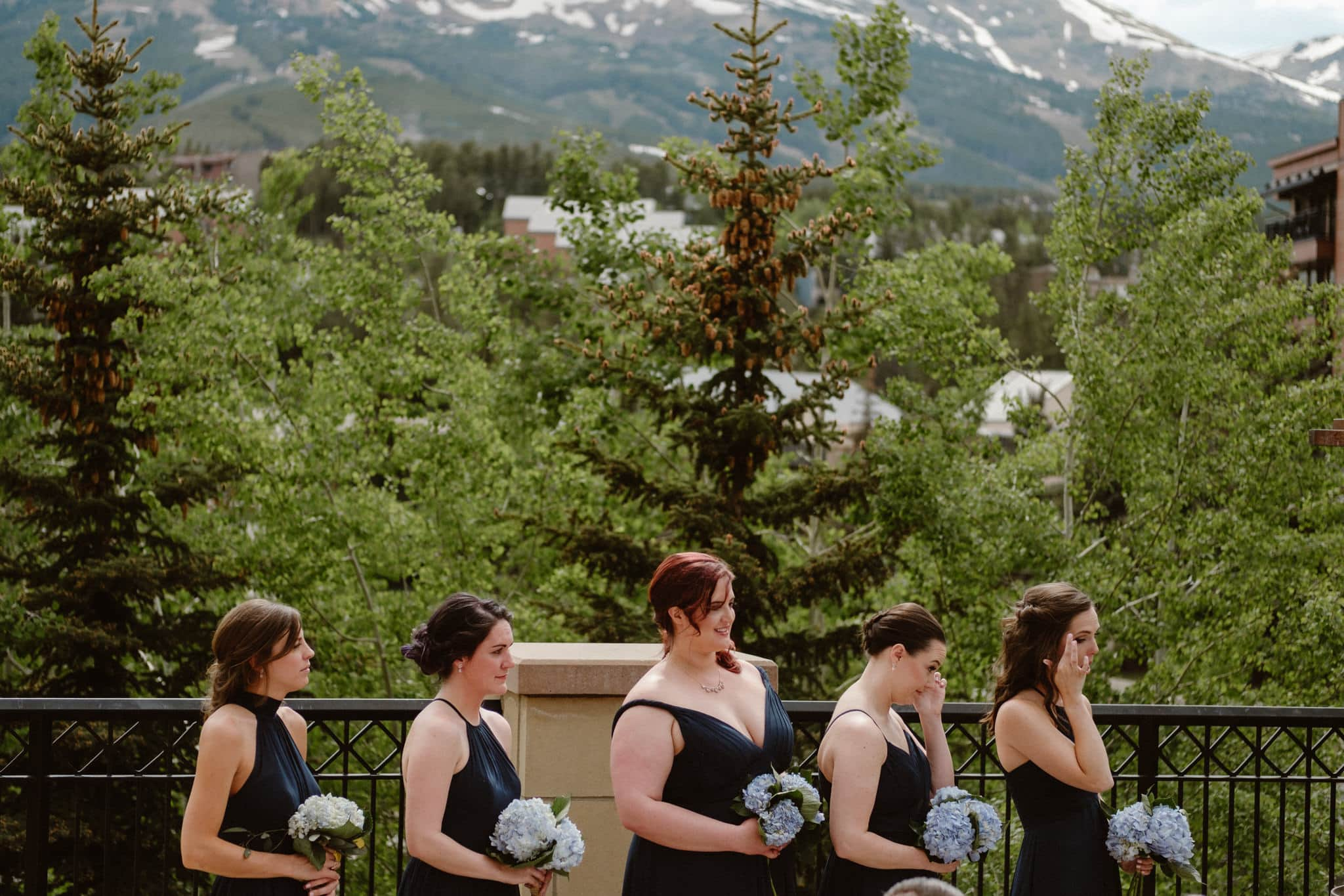 Bridesmaids wiping tears during Main Street Station wedding ceremony, Breckenridge wedding photographer