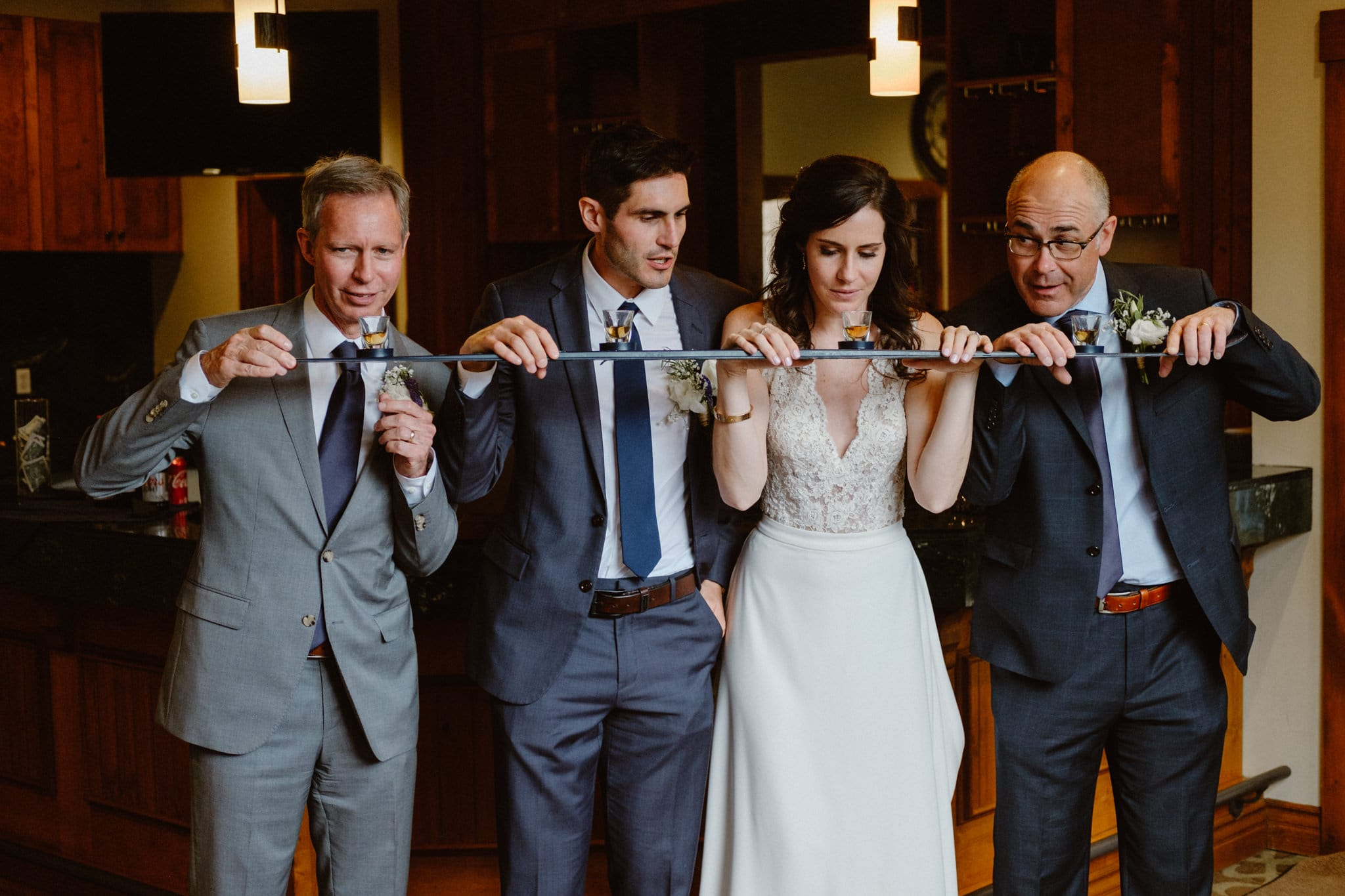 Bride and groom do shotski with their dads at Breckenridge wedding, Colorado wedding photographer