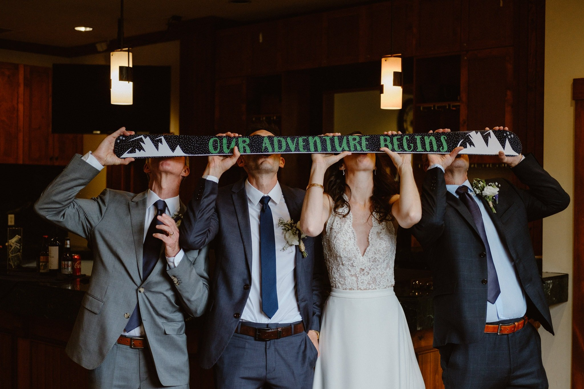 "Bride and groom do shotski that says ""Our adventure begins"" with their dads at Breckenridge wedding, Colorado wedding photographer"
