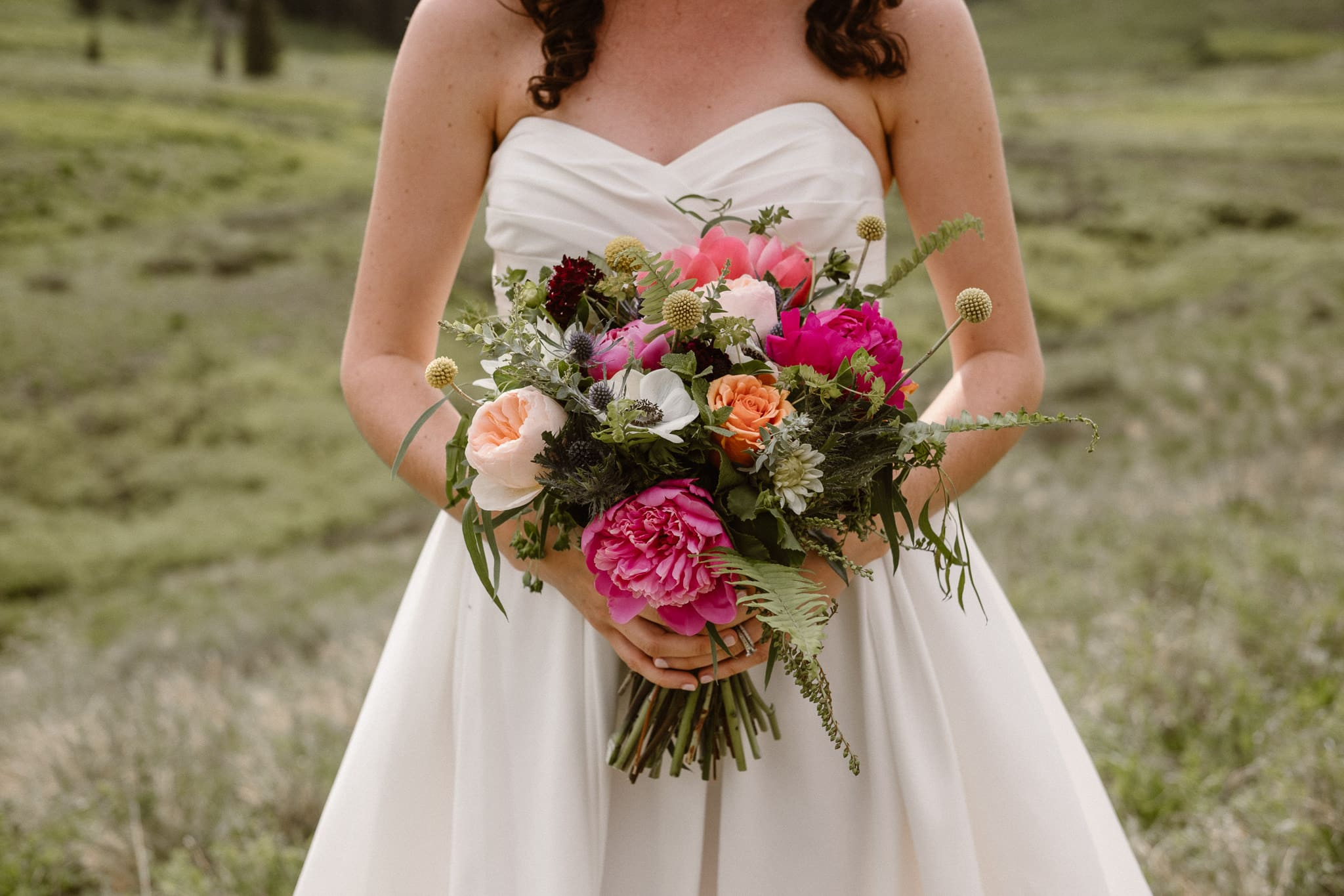 Crested Butte elopement photographer, Colorado adventure wedding photographer, bride holding bouquet by From the Ground Up Flowers