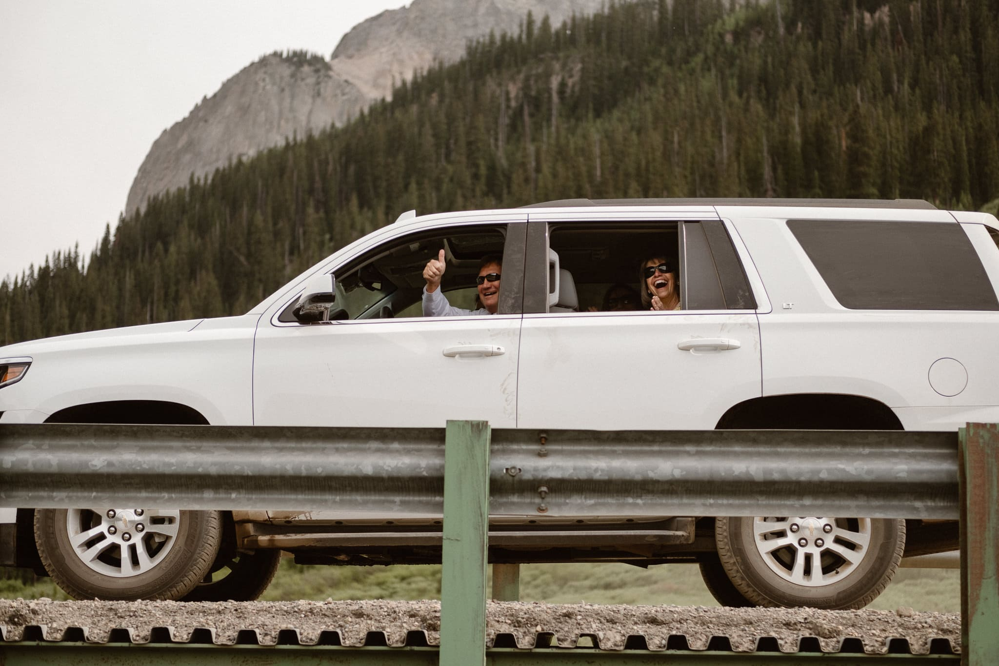 Crested Butte elopement photographer, Colorado adventure wedding photographer, grom's family driving by