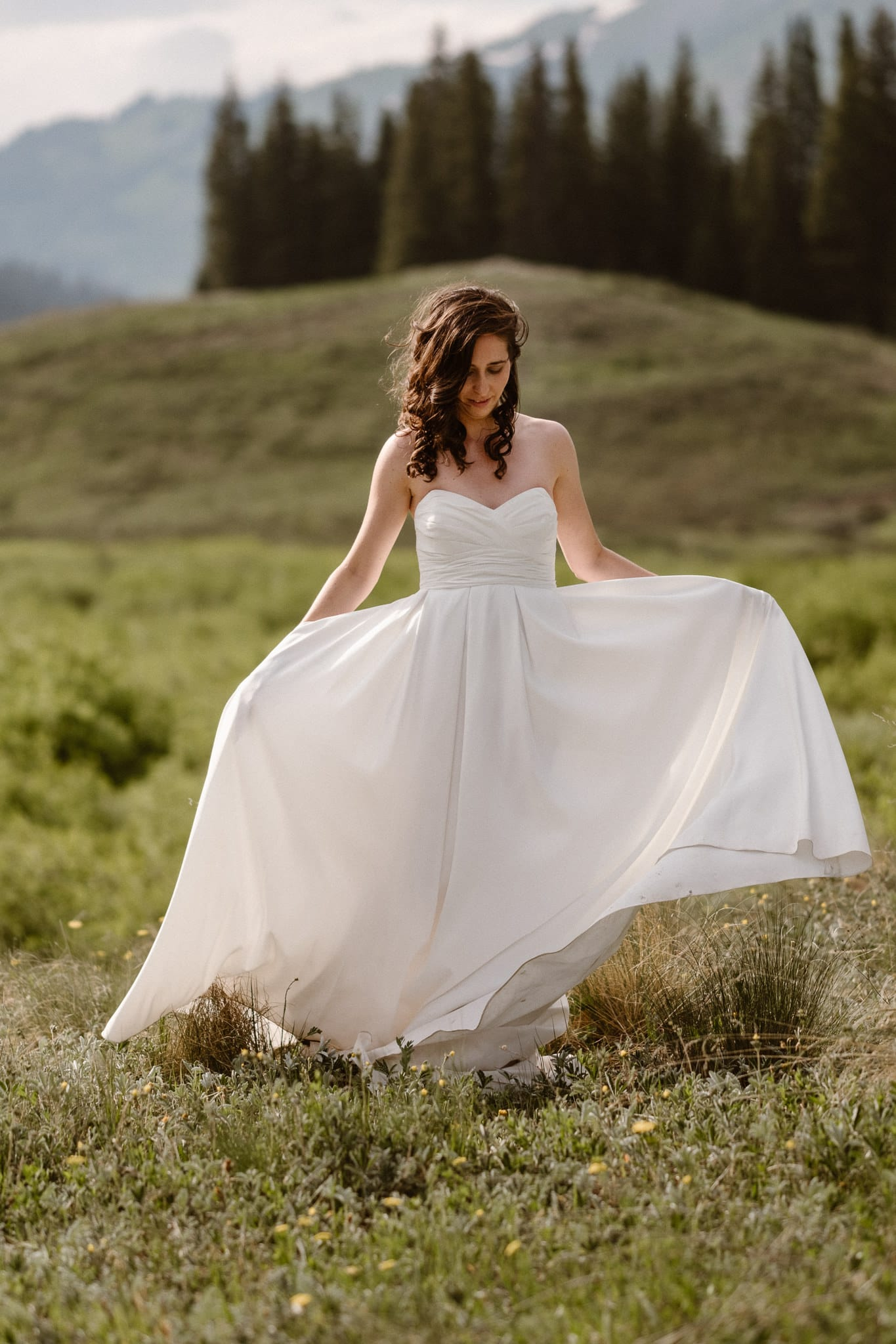 Crested Butte elopement photographer, Colorado adventure wedding photographer, bride twirling in dress with pockets