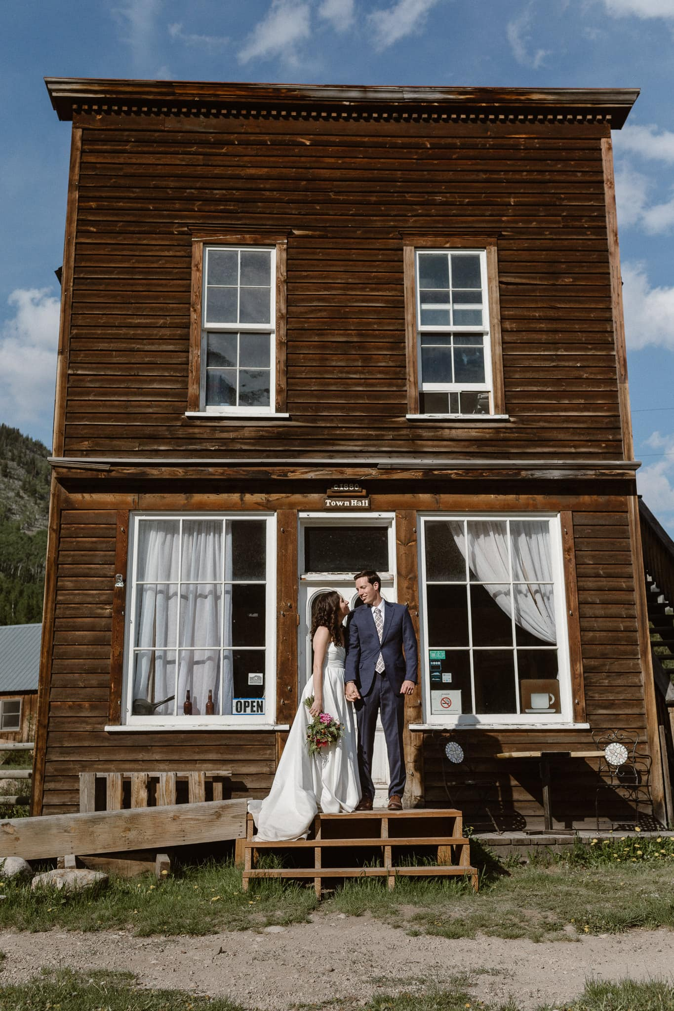 Crested Butte elopement photographer, Colorado adventure wedding photographer, bride and groom portraits at Gothic Town Hall
