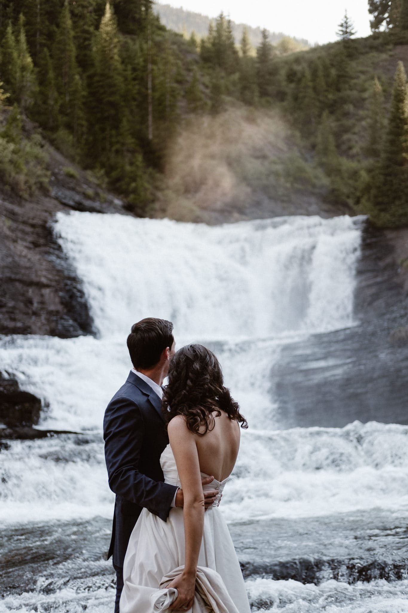 Crested Butte elopement photographer, Colorado adventure wedding photographer, bride and groom portraits at secret waterfall