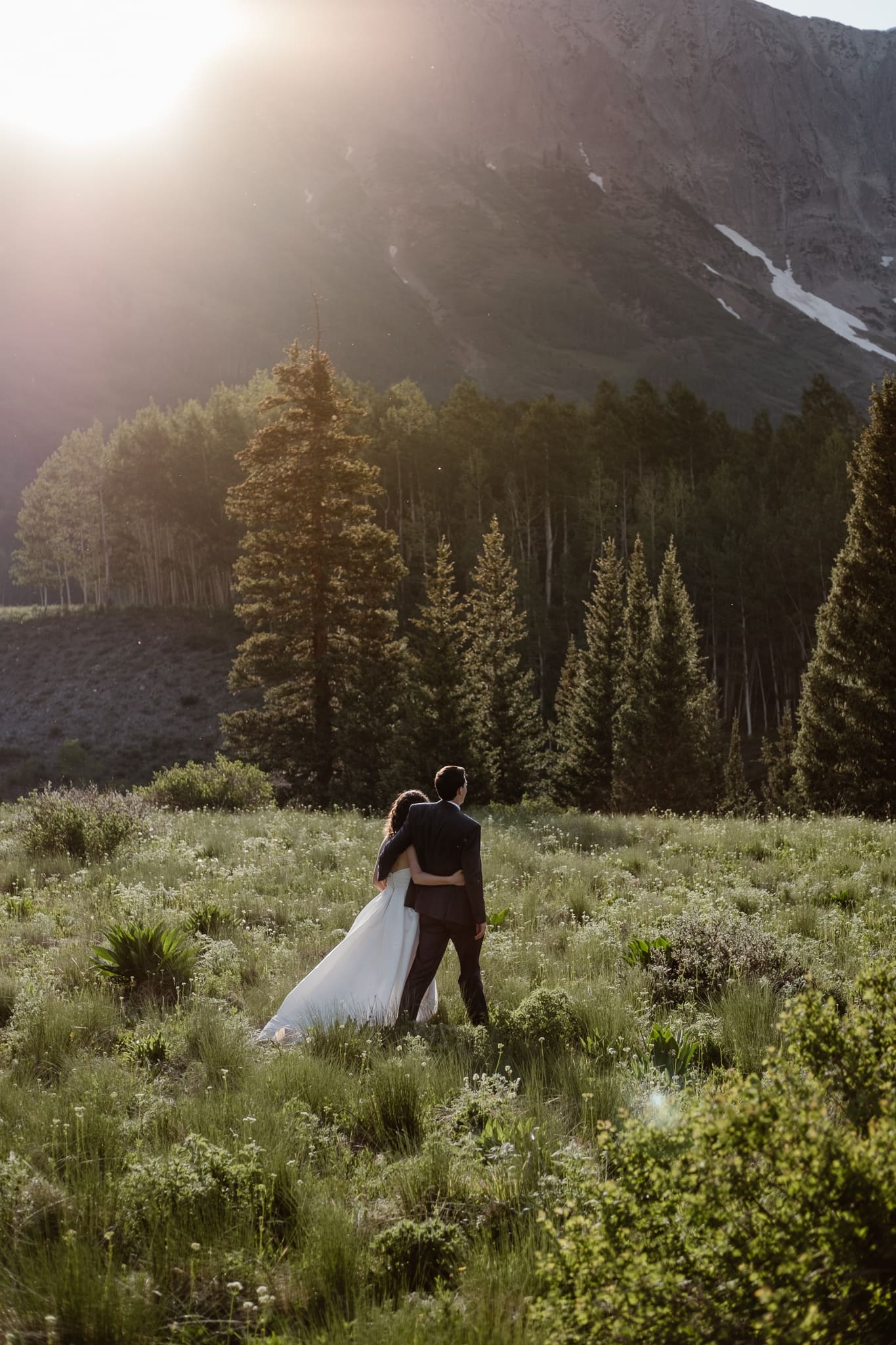 Crested Butte elopement photographer, Colorado adventure wedding photographer, bride and groom hiking at sunset