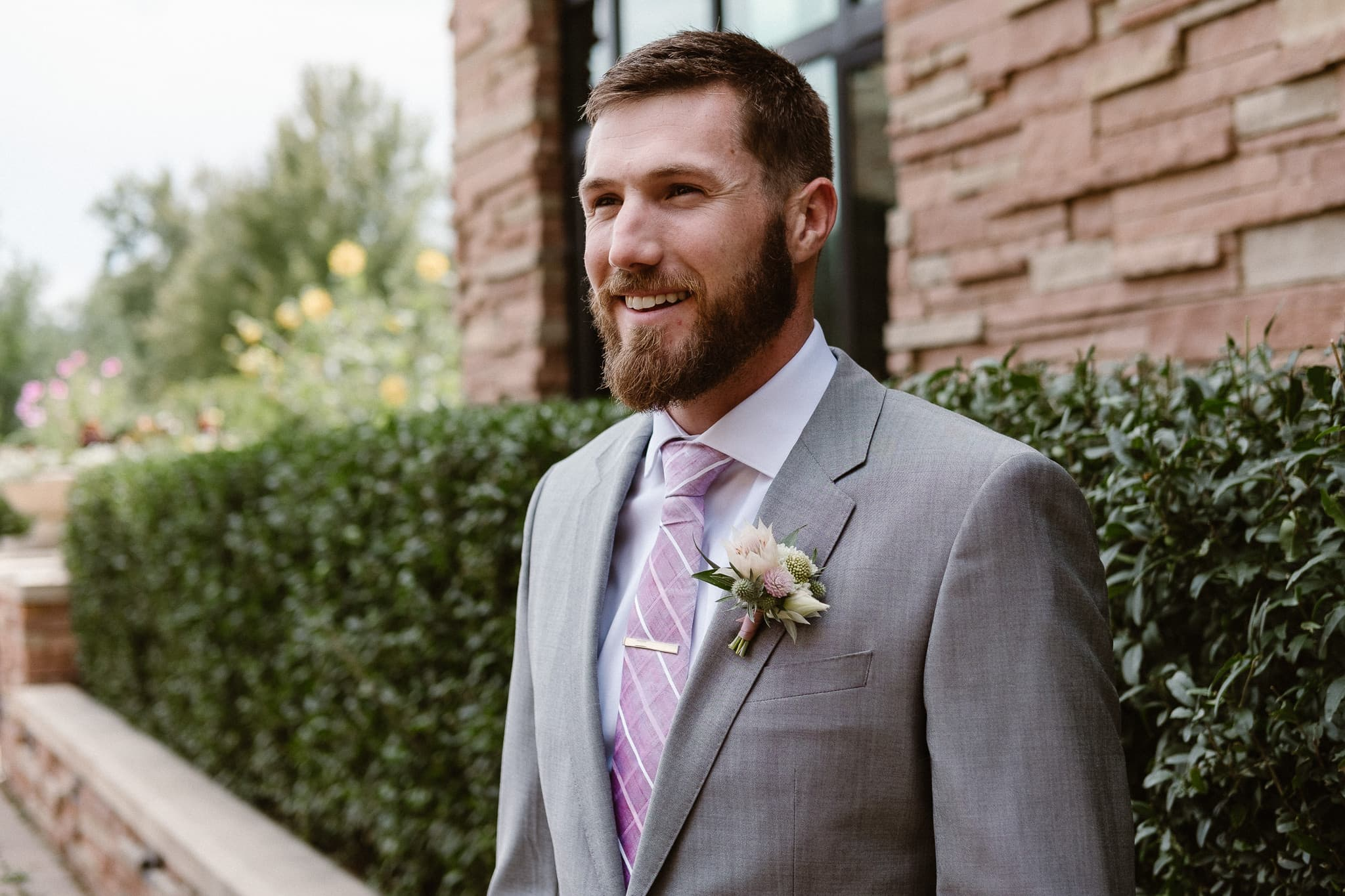 Groom getting ready for Colorado mountain elopement at St. Julien Hotel, Boulder wedding photographer, groom portrait,