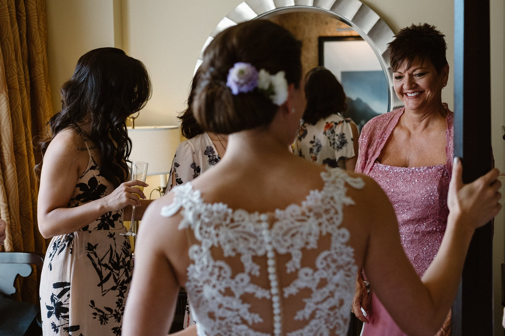 Bride getting ready for Colorado mountain elopement at St. Julien Hotel, Boulder wedding photographer, bride putting on dress, bride's mom looking on