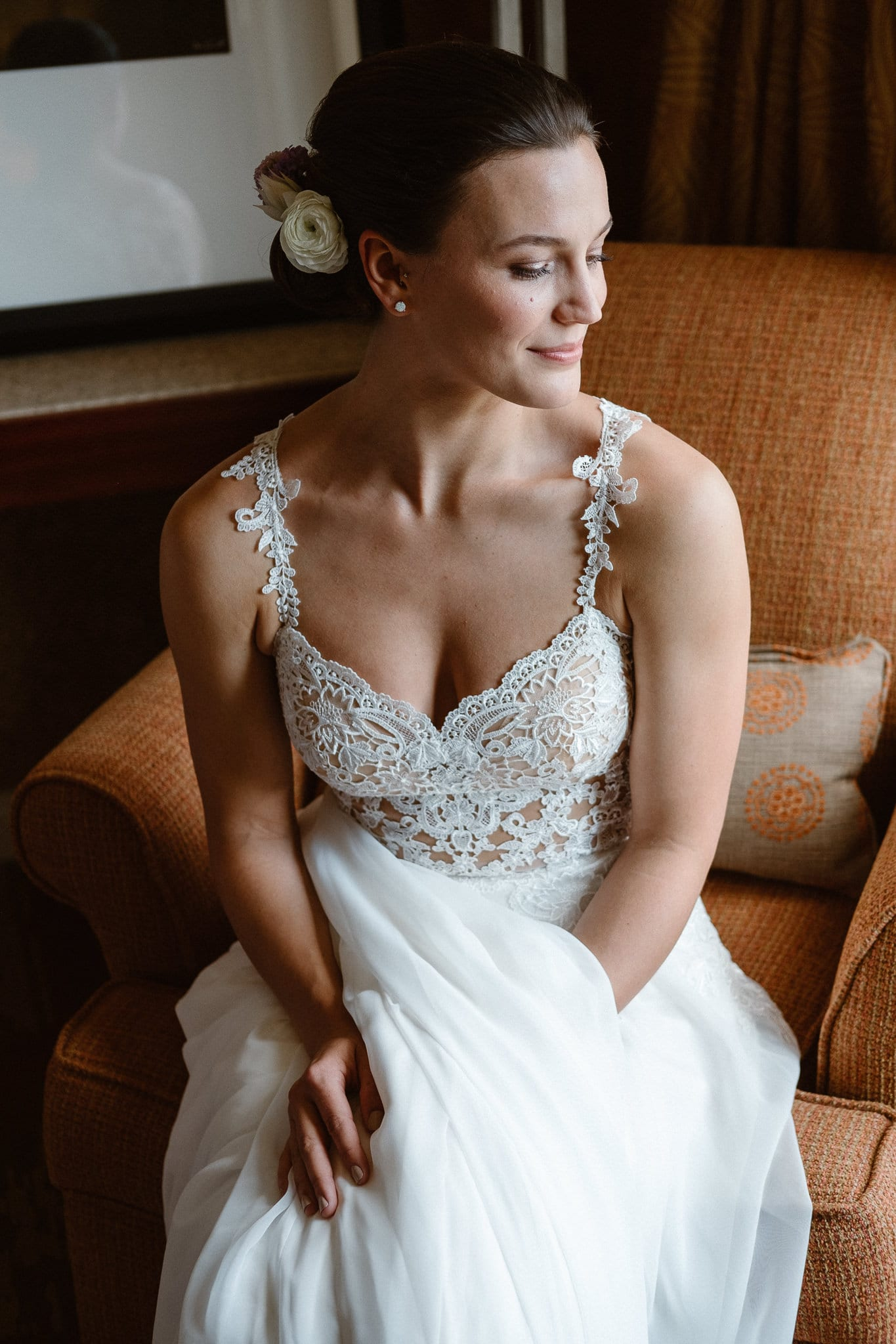 Bride getting ready for Colorado mountain elopement at St. Julien Hotel, Boulder wedding photographer, classic bridal portrait