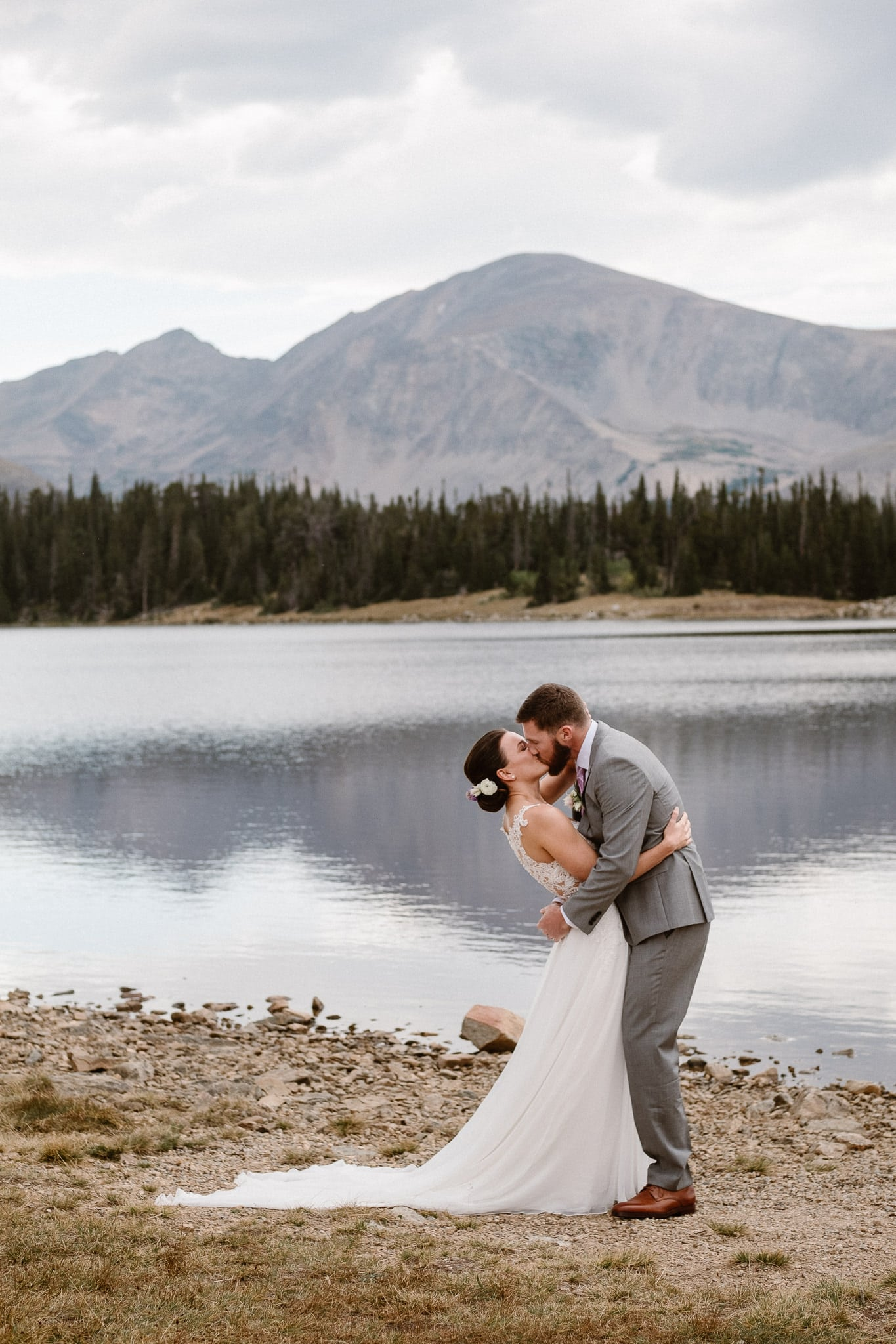 Colorado mountain elopement photographer, alpine lake adventure wedding, Boulder wedding photographer, outdoor ceremony, first kiss