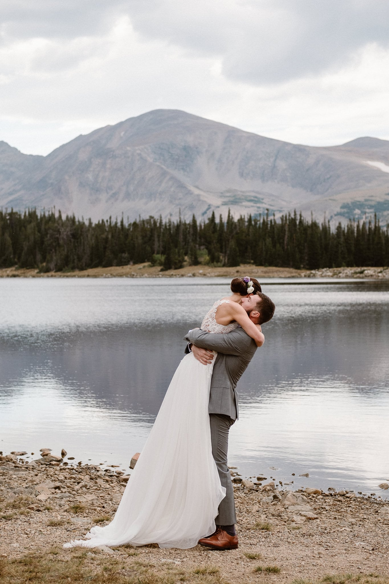 Colorado mountain elopement photographer, alpine lake adventure wedding, Boulder wedding photographer, outdoor ceremony, first kiss, groom lifting bride