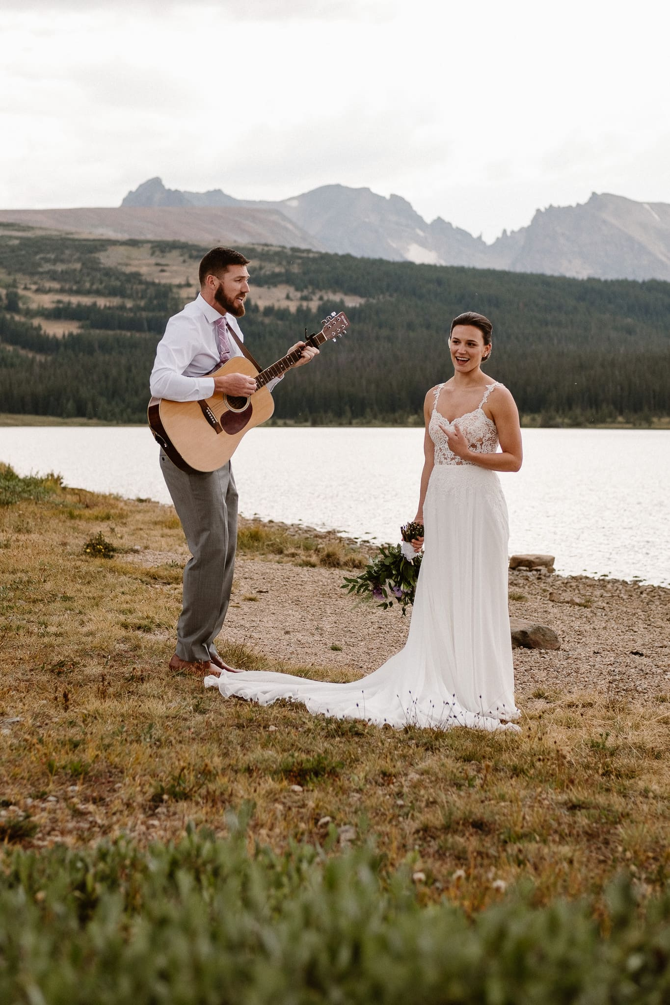 Colorado mountain elopement photographer, alpine lake adventure wedding, Boulder wedding photographer, groom playing guitar and singing to bride