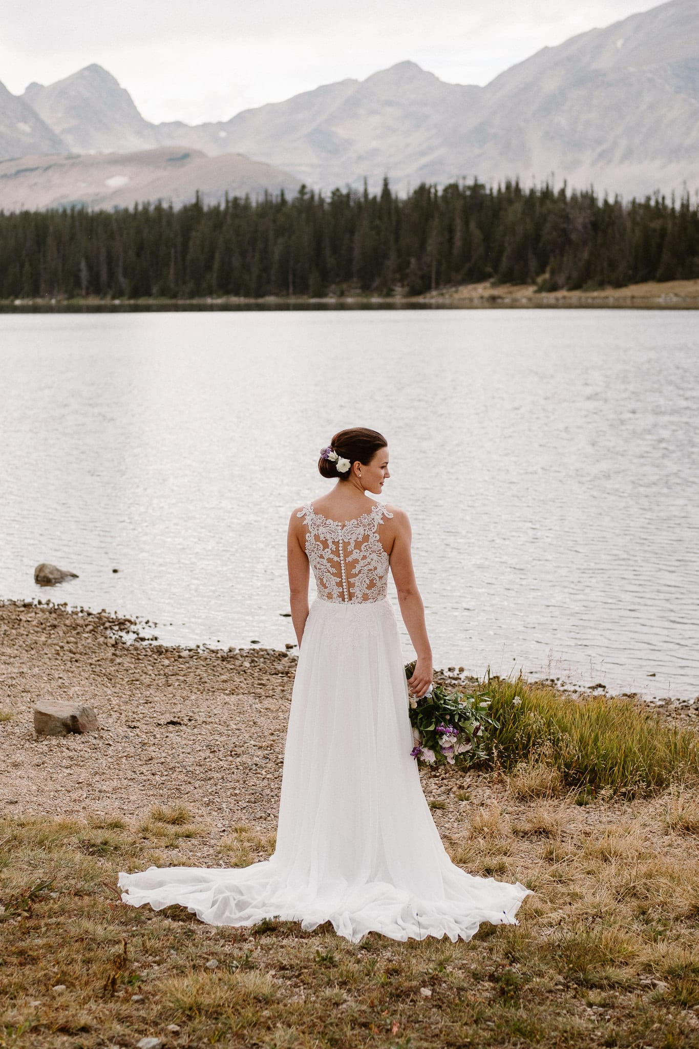 Colorado mountain elopement photographer, alpine lake adventure wedding, Boulder wedding photographer, bride in mountains, wedding dress with lace back