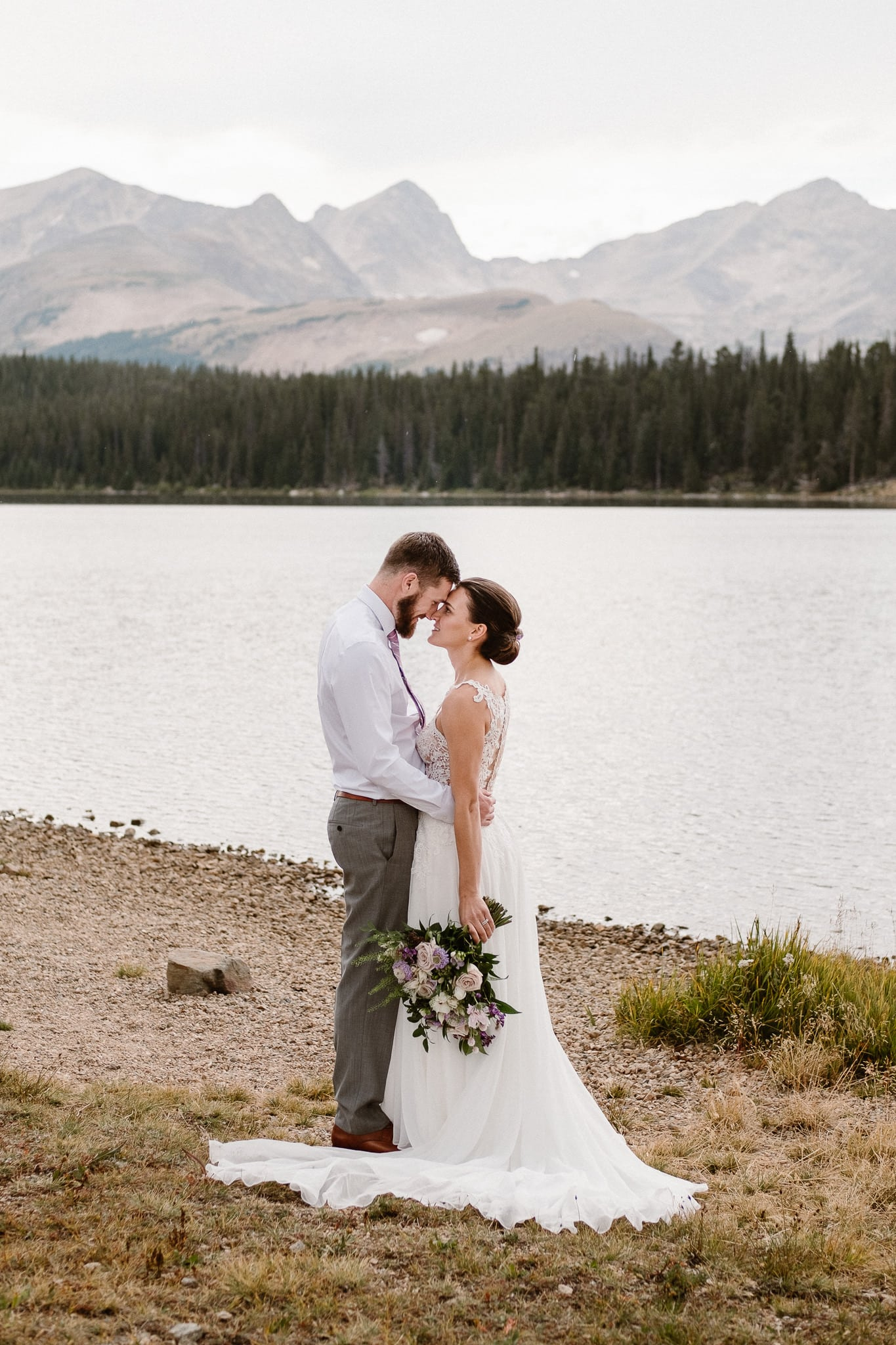 Colorado mountain elopement photographer, alpine lake adventure wedding, Boulder wedding photographer, bride and groom portraits in mountains,