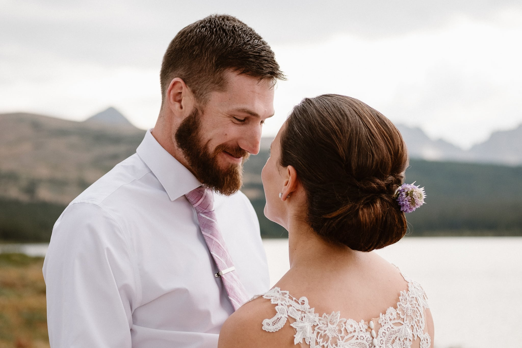 Colorado mountain elopement photographer, alpine lake adventure wedding, Boulder wedding photographer, bride and groom portraits in mountains, laidback boho wedding