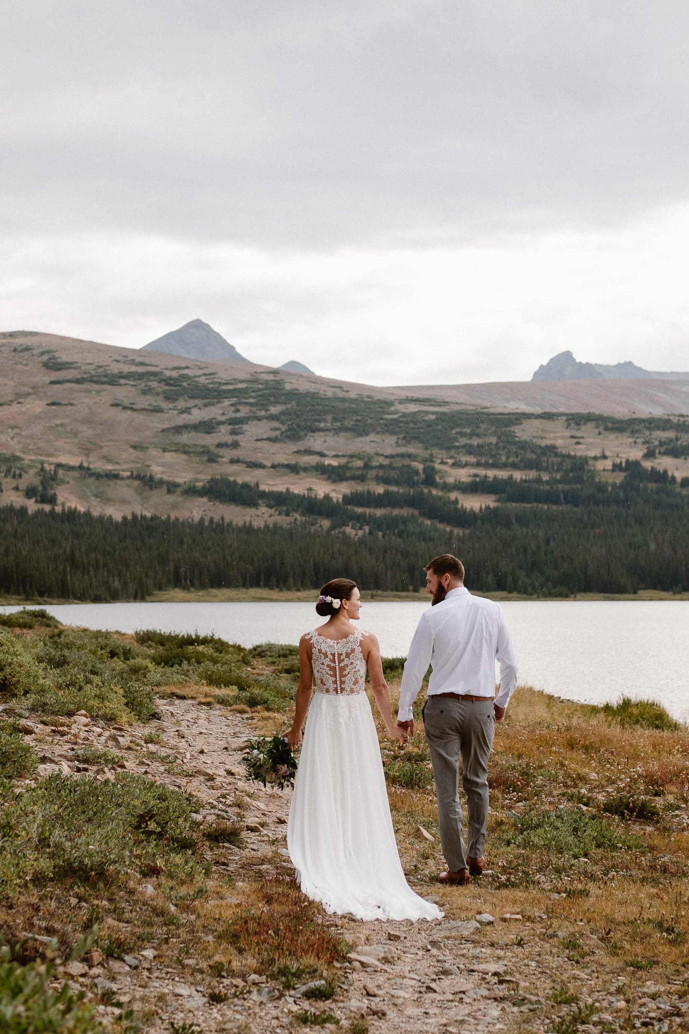 Colorado mountain elopement photographer, alpine lake adventure wedding, Boulder wedding photographer, bride and groom portraits in mountains, laidback boho wedding, hiking elopement