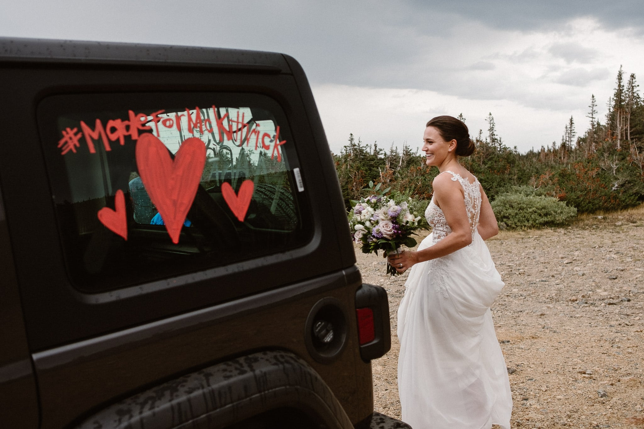 Colorado mountain elopement photographer, alpine lake adventure wedding, Boulder wedding photographer, bride and groom portraits in mountains, laidback boho wedding, hiking elopement, bride with Jeep