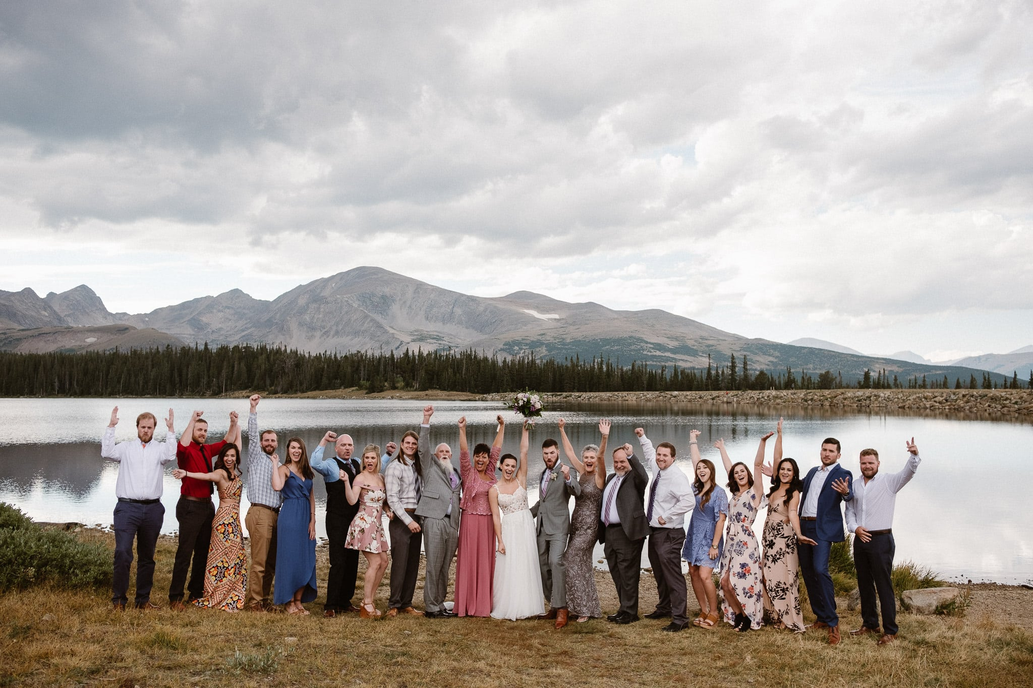 Colorado mountain elopement photographer, alpine lake adventure wedding, Boulder wedding photographer, bride and groom portraits in mountains, laidback boho wedding, hiking elopement, wedding party, wedding guests group photo