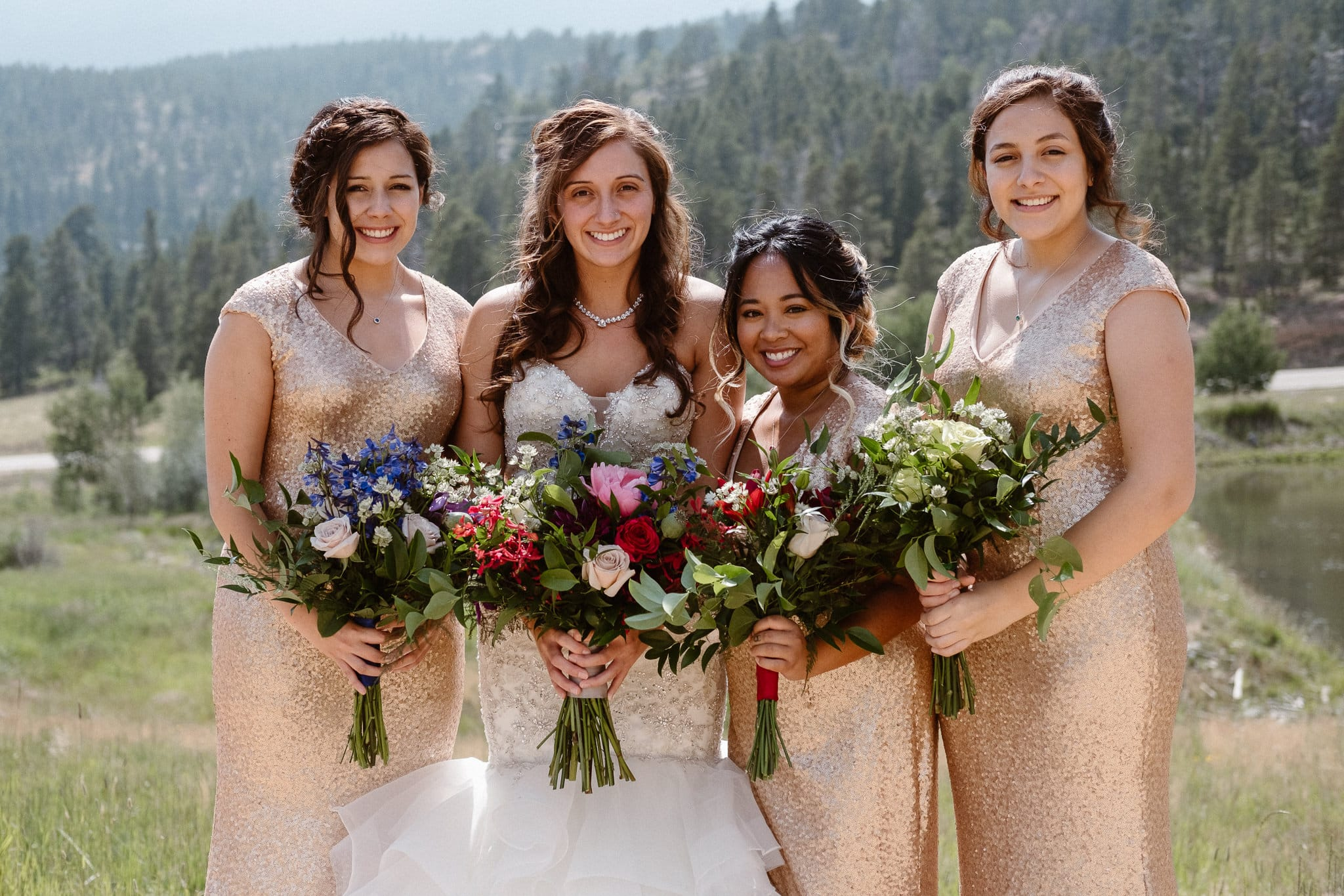 Dao House wedding photographer, Estes Park wedding venue, Colorado mountain wedding, bride and bridesmaids, gemstone colored wedding bouquets, gold sequin bridesmaids dresses