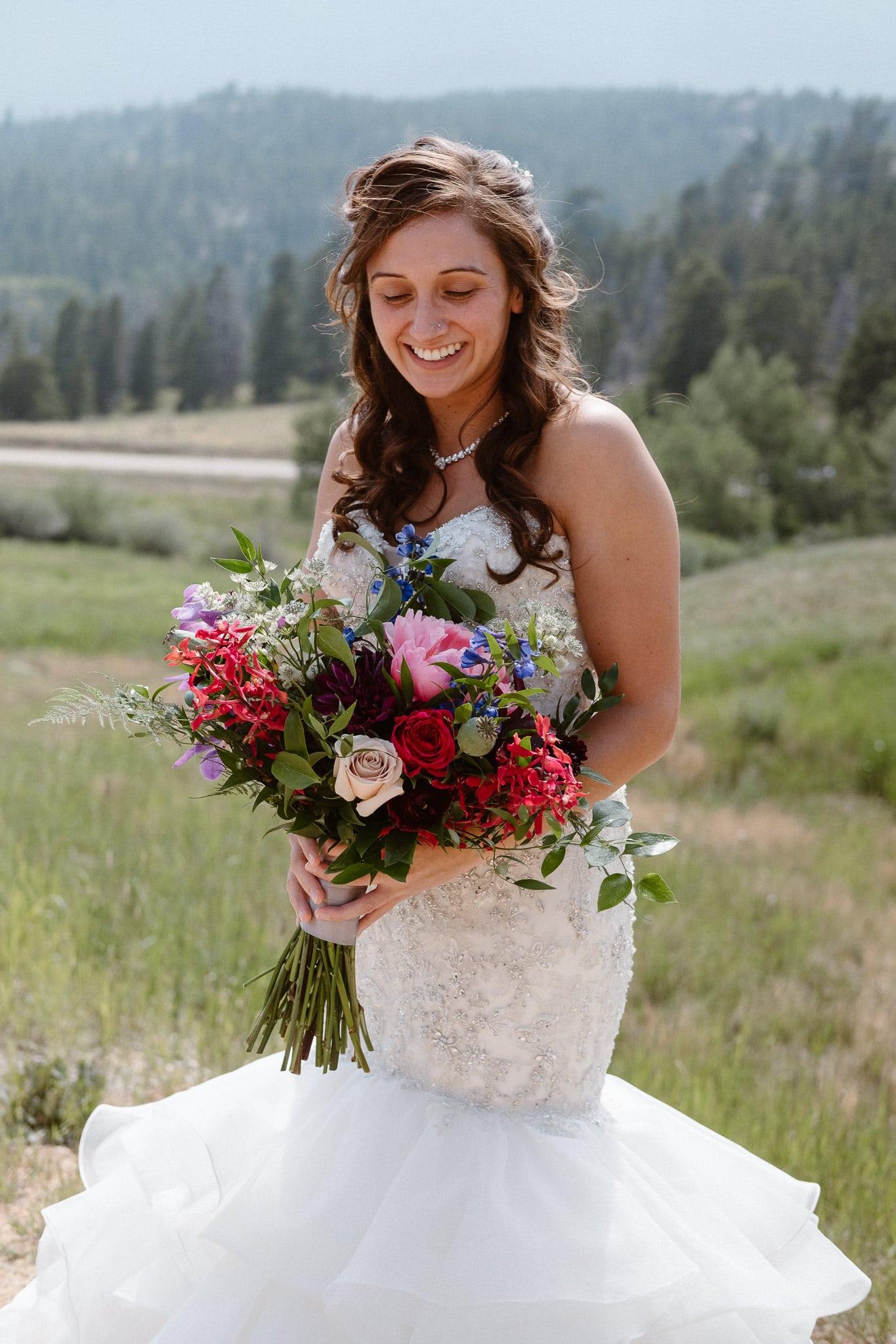Dao House wedding photographer, Estes Park wedding venue, Colorado mountain wedding, bride holding jewel tone wedding bouquet
