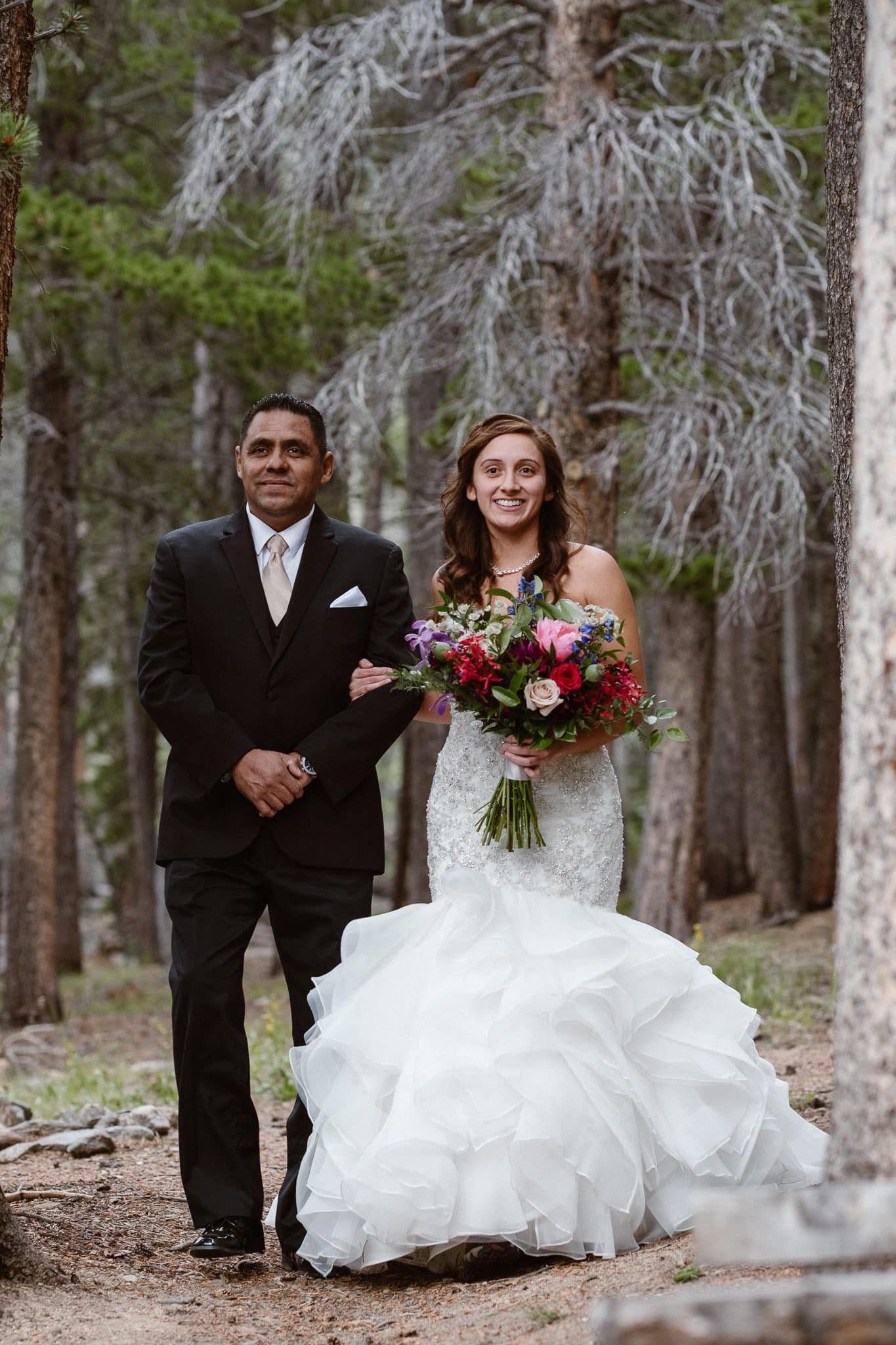Dao House wedding photographer, Estes Park wedding venue, Colorado mountain wedding, bride and father walking down the aisle, outdoor ceremony, wedding in the woods,