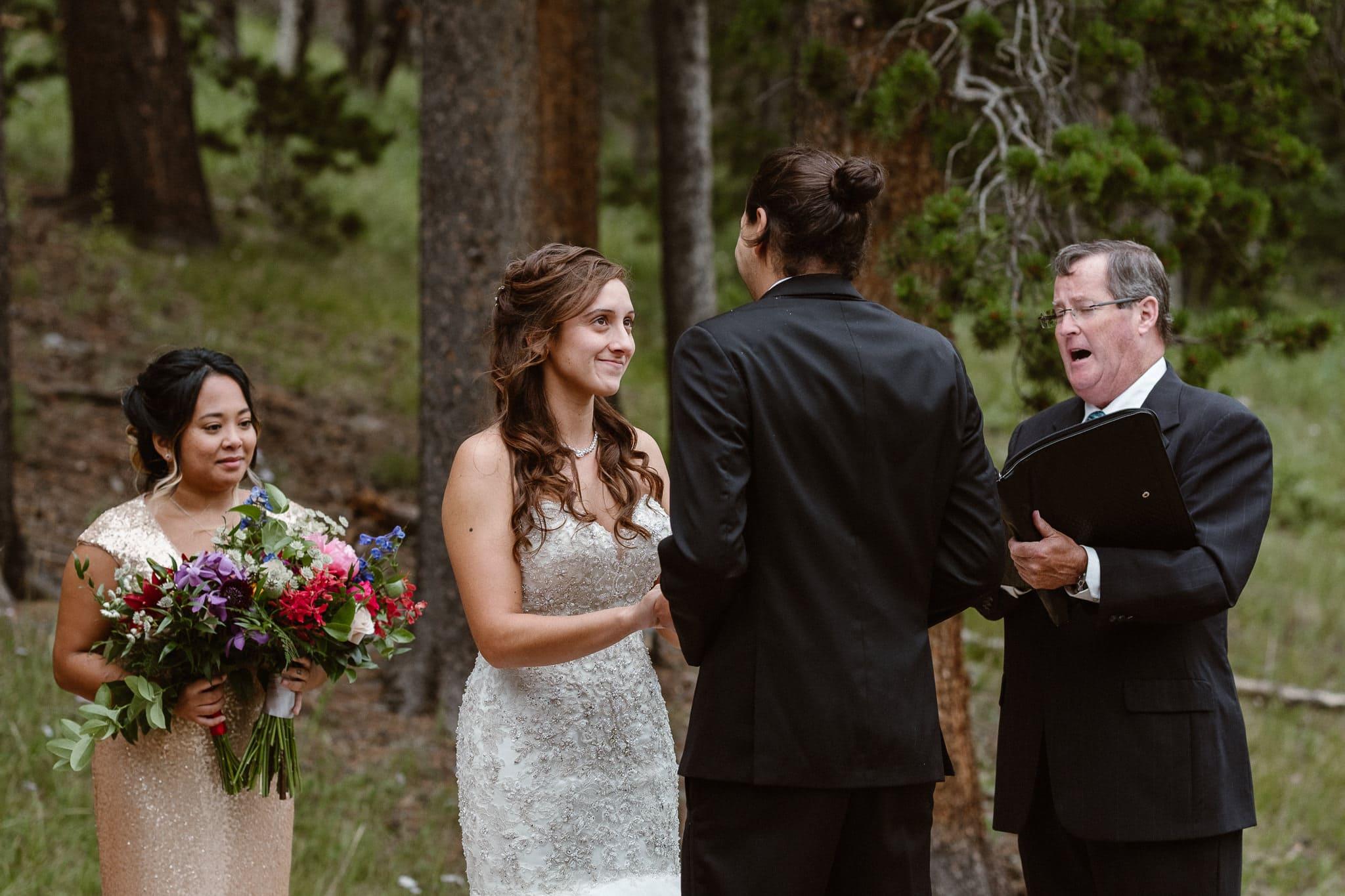Dao House wedding photographer, Estes Park wedding venue, Colorado mountain wedding, outdoor ceremony, mountain ceremony, bride and groom exchanging vows