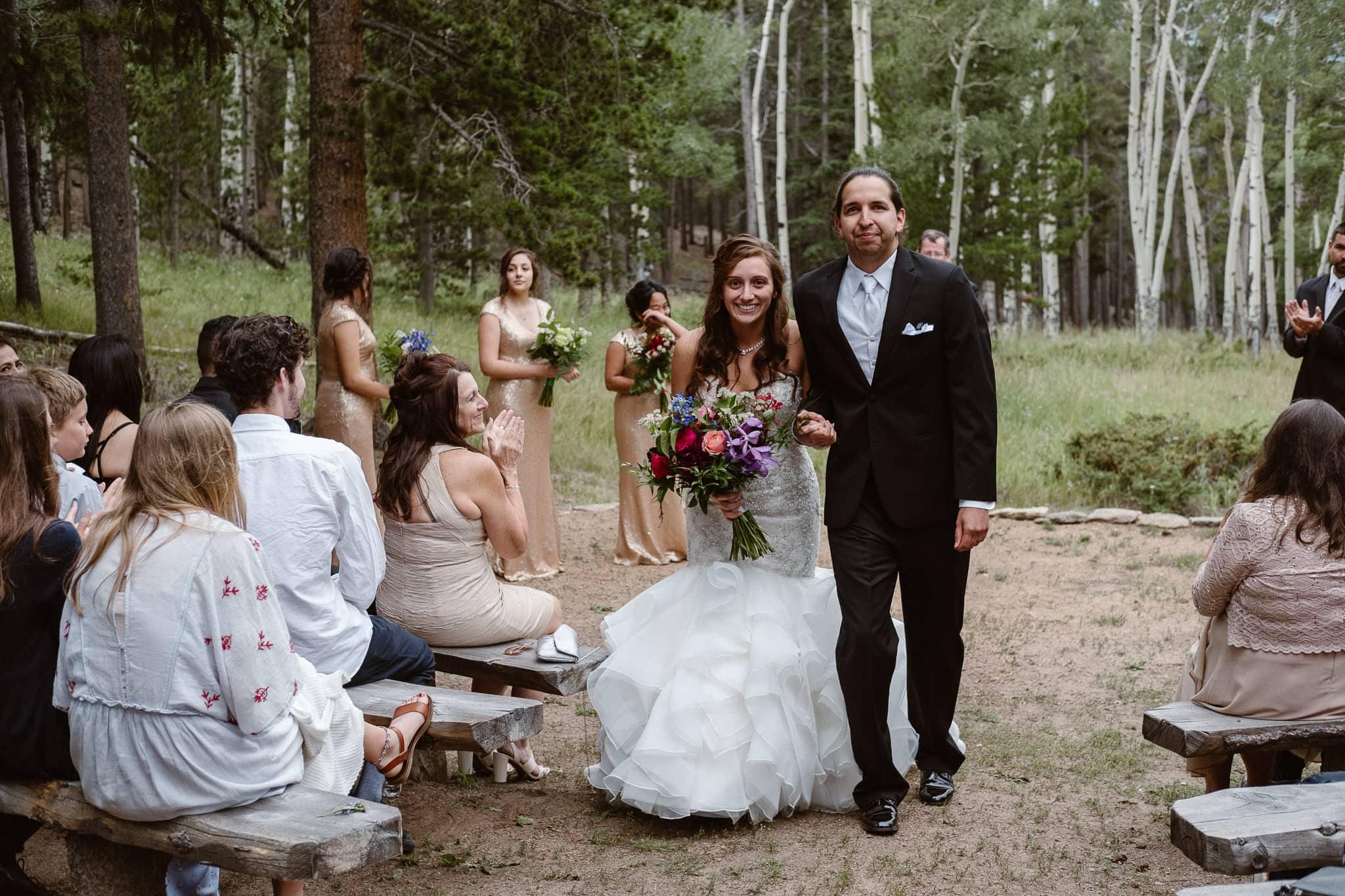 Dao House wedding photographer, Estes Park wedding venue, Colorado mountain wedding, outdoor ceremony, mountain ceremony, bride and groom walking down aisle, recessional