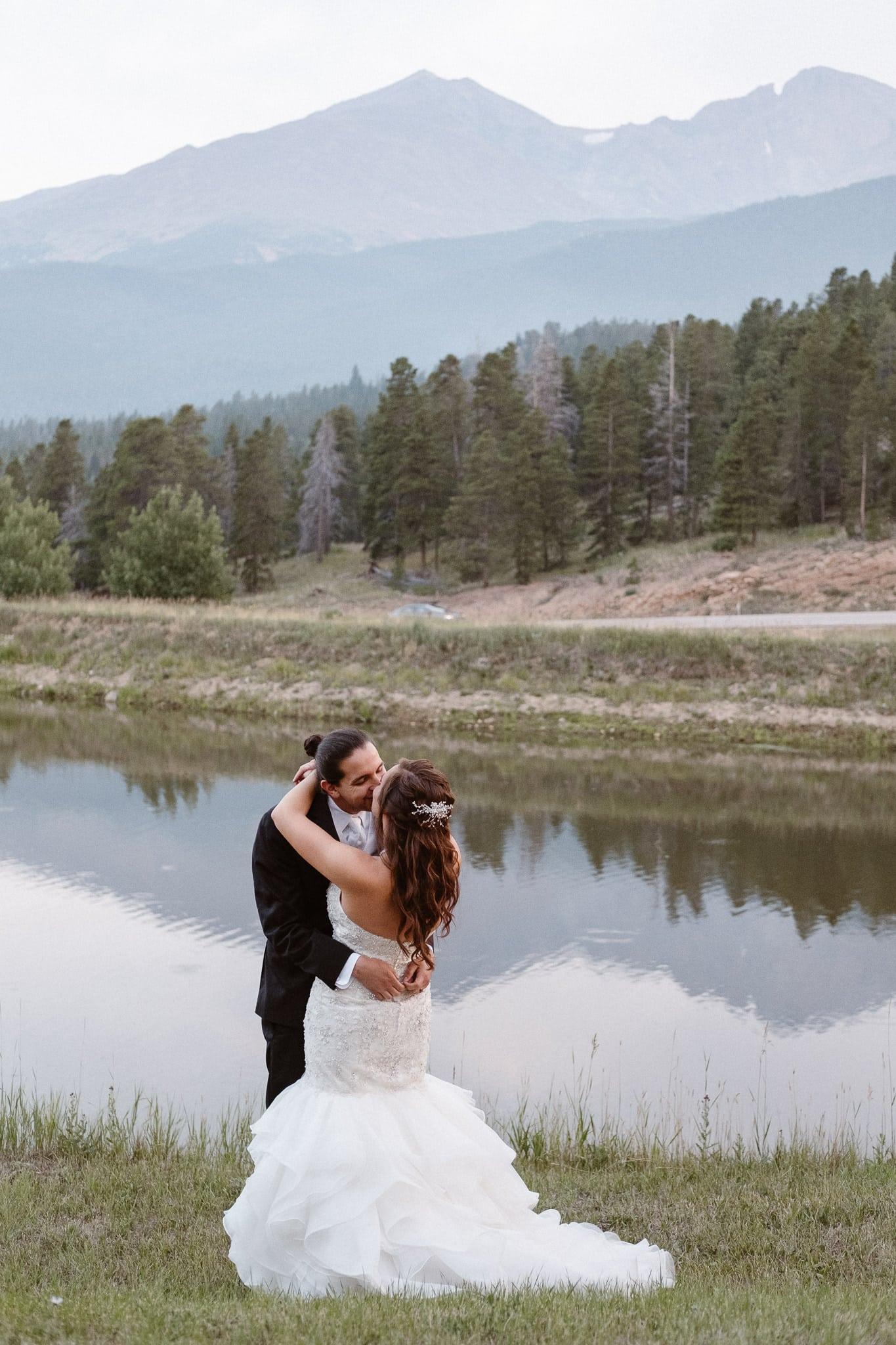 Dao House wedding photographer, Estes Park wedding venue, Colorado mountain wedding, bride and groom walking by pond,