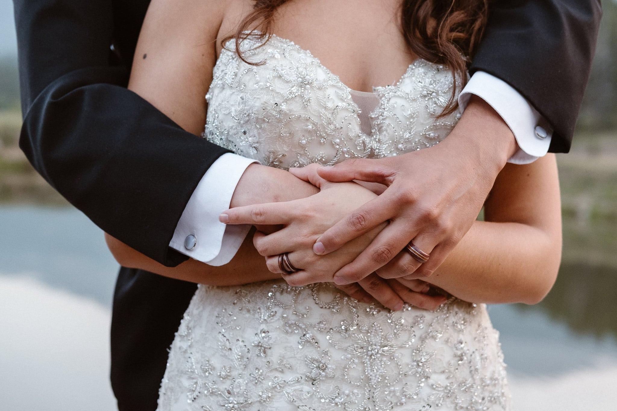 Dao House wedding photographer, Estes Park wedding venue, Colorado mountain wedding, bride and groom arms wrapped, wedding portraits