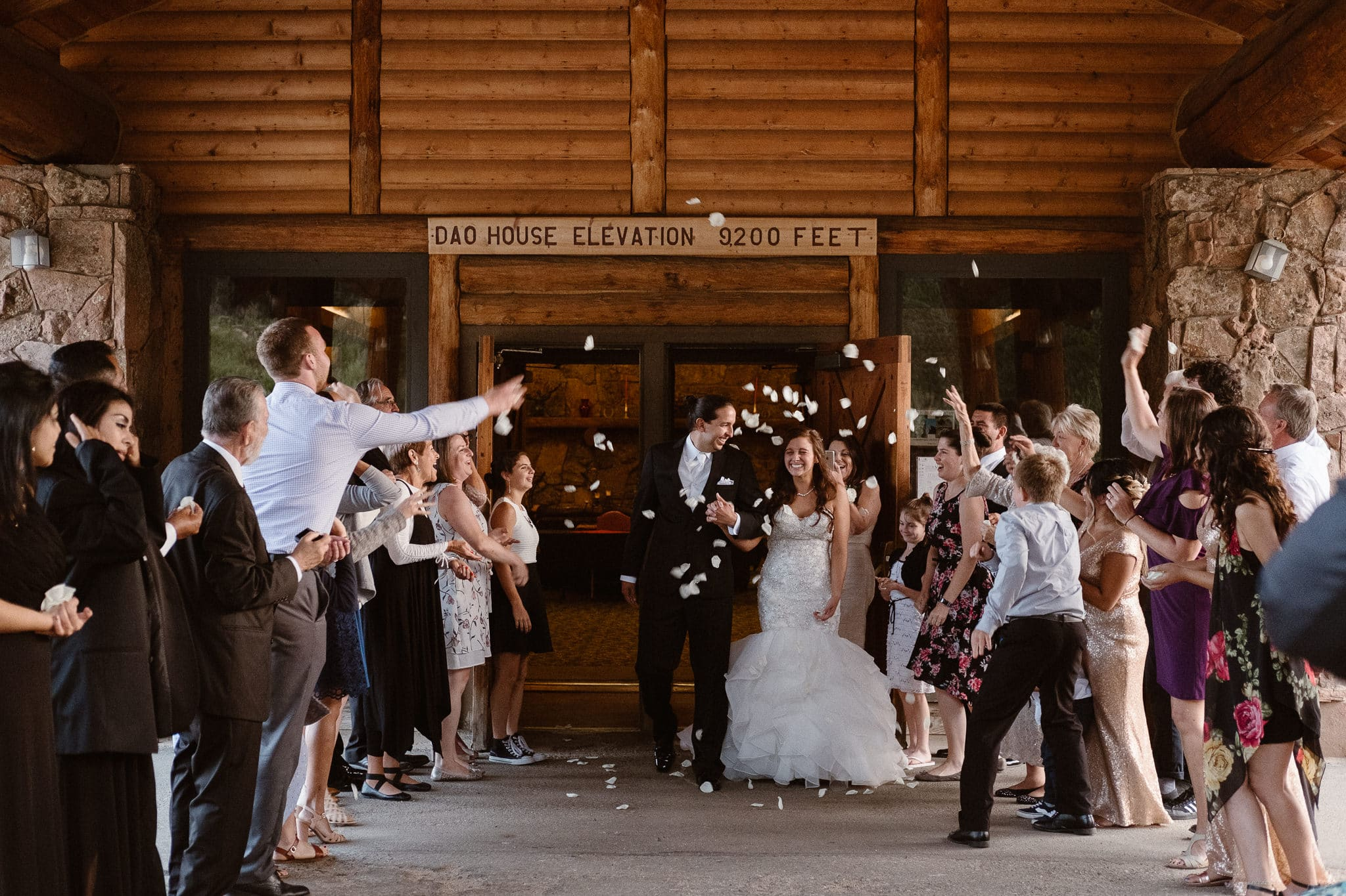Dao House wedding photographer, Estes Park wedding venue, Colorado mountain wedding, bride and groom flower petal exit, grand exit, flower petal sendoff