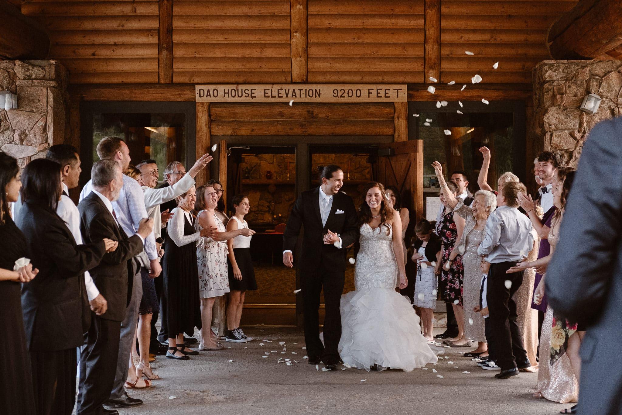 Dao House wedding photographer, Estes Park wedding venue, Colorado mountain wedding, bride and groom flower petal exit, grand exit, flower petal sendoff