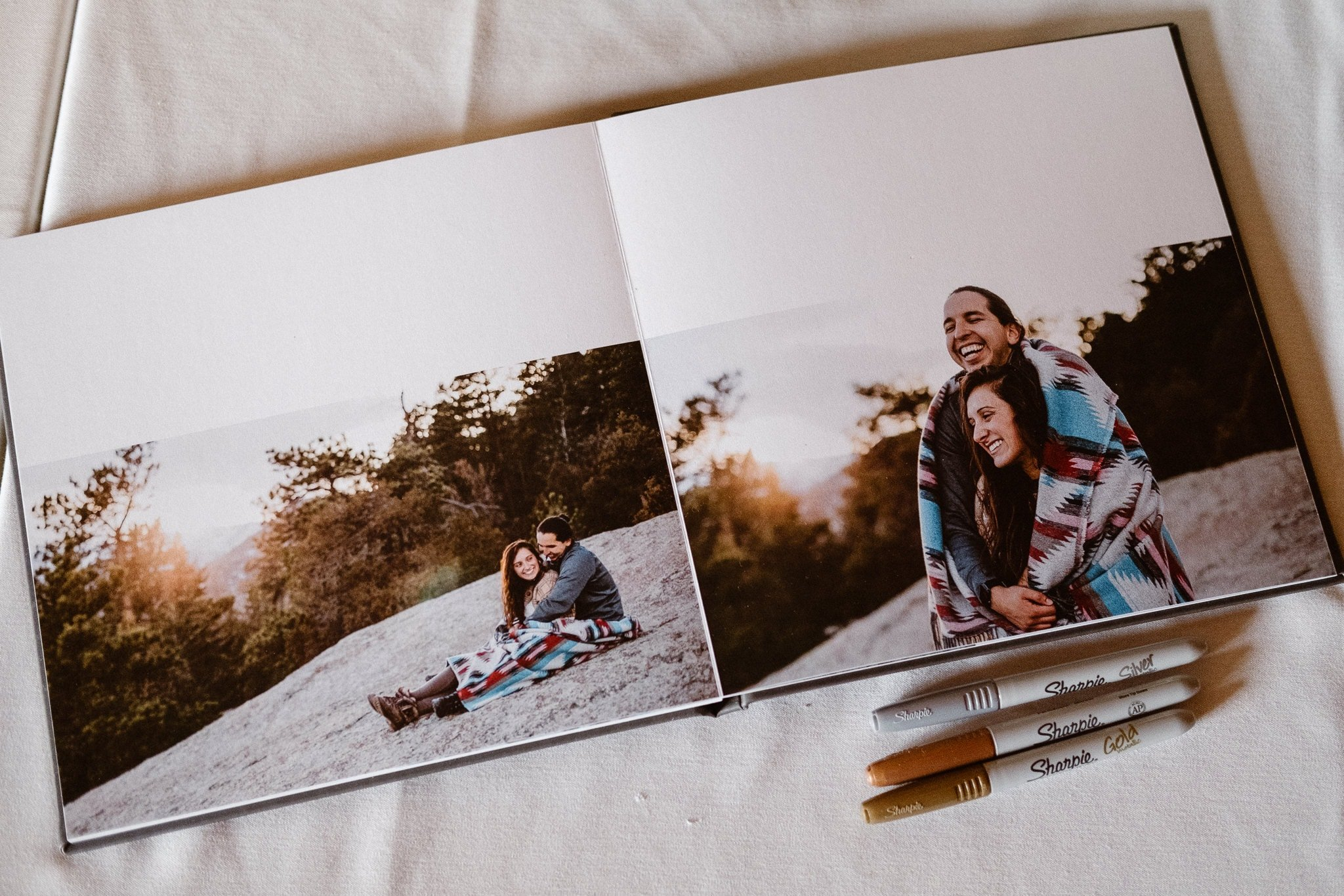 Wedding guest book with engagement photos.