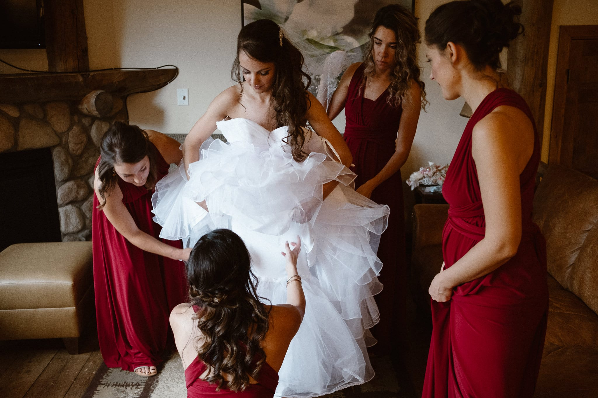 Lodge at Breckenridge Wedding Photographer, Colorado mountain wedding photographer, intimate wedding, bride getting ready, bridesmaids in deep red dresses