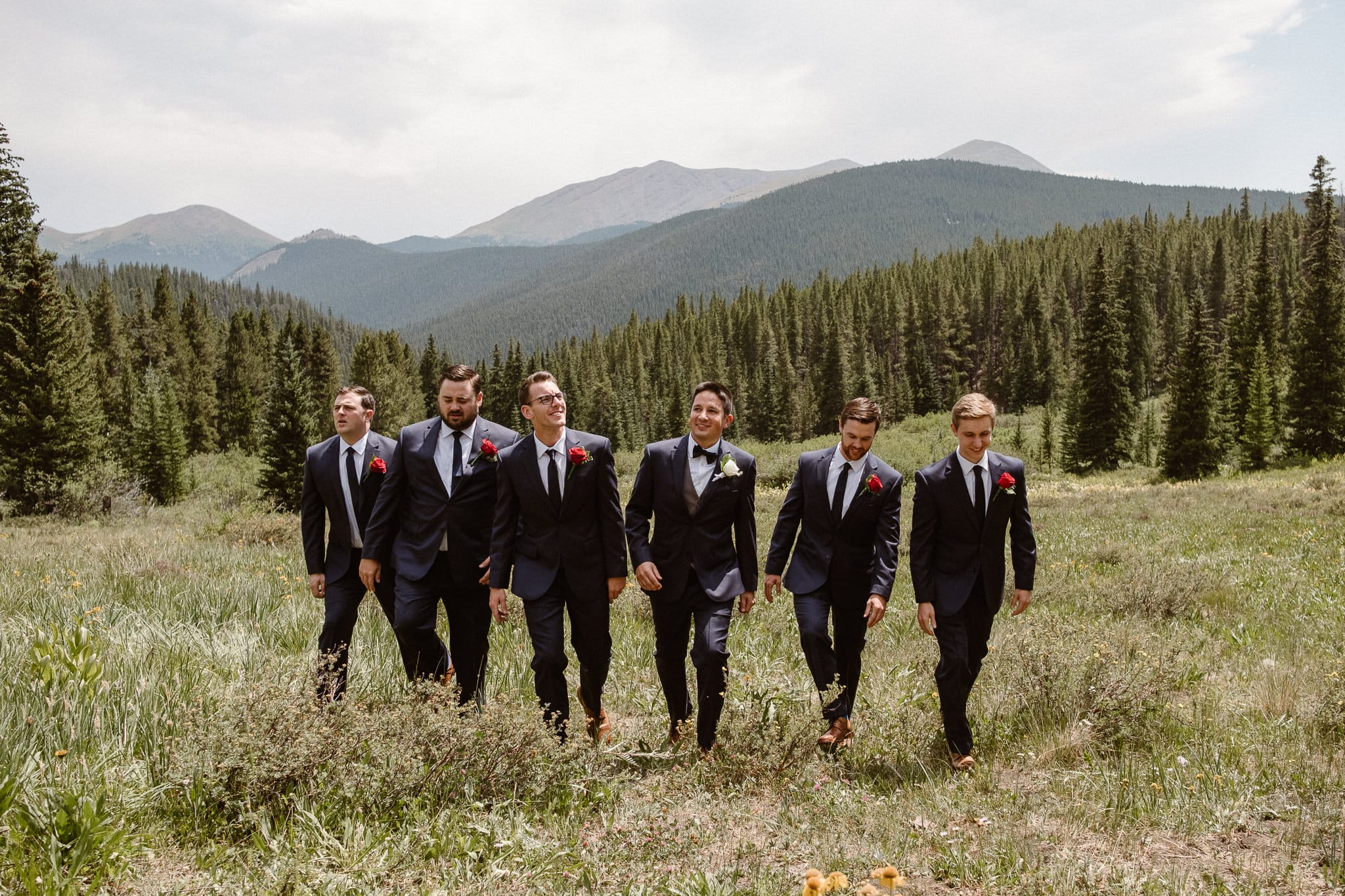 Lodge at Breckenridge Wedding Photographer, Colorado mountain wedding photographer, intimate wedding, groom with groomsmen, dark suits, red rose boutonnieres