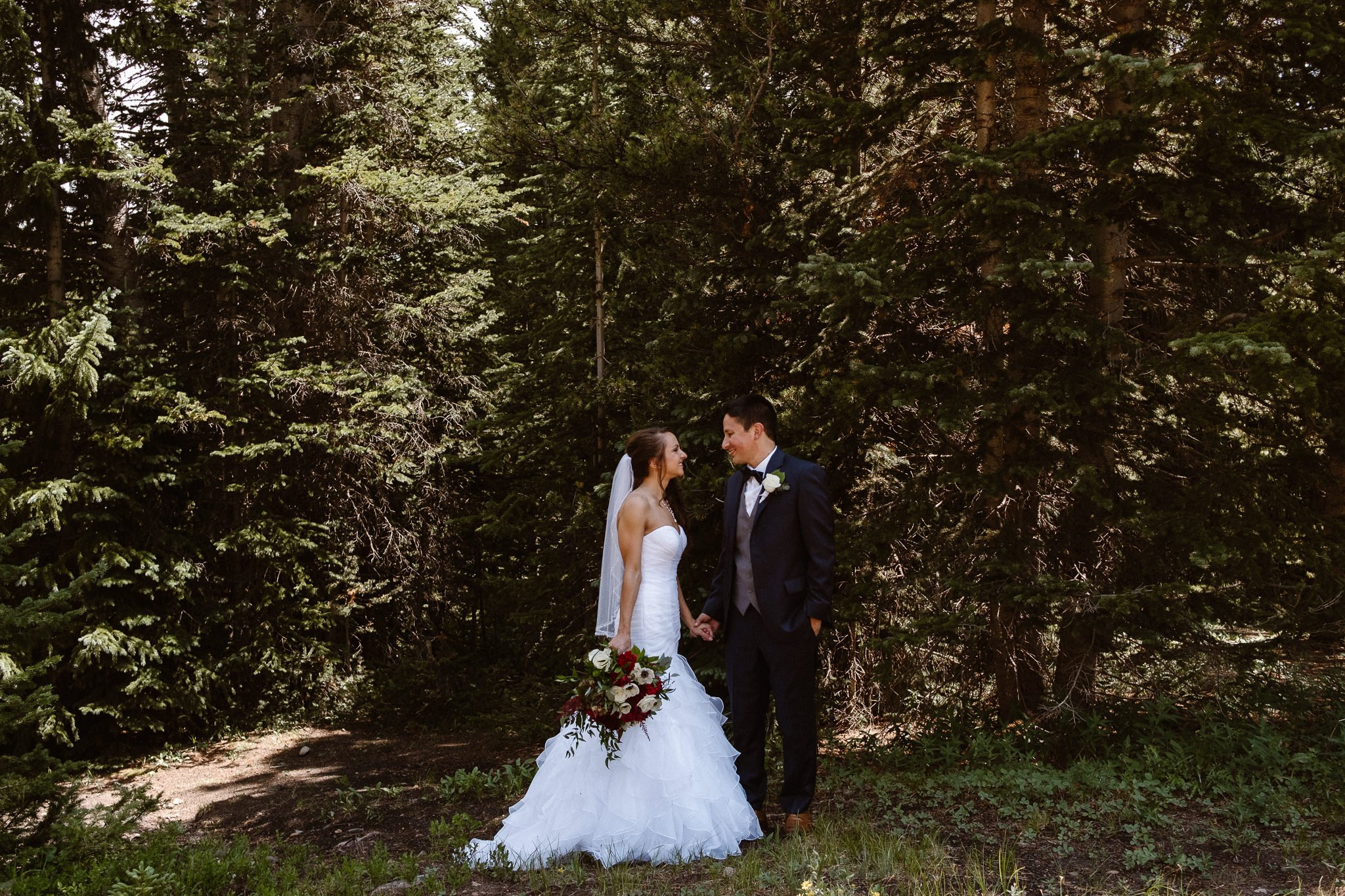 Bride and groom in the woods at The Lodge at Breckenridge wedding.