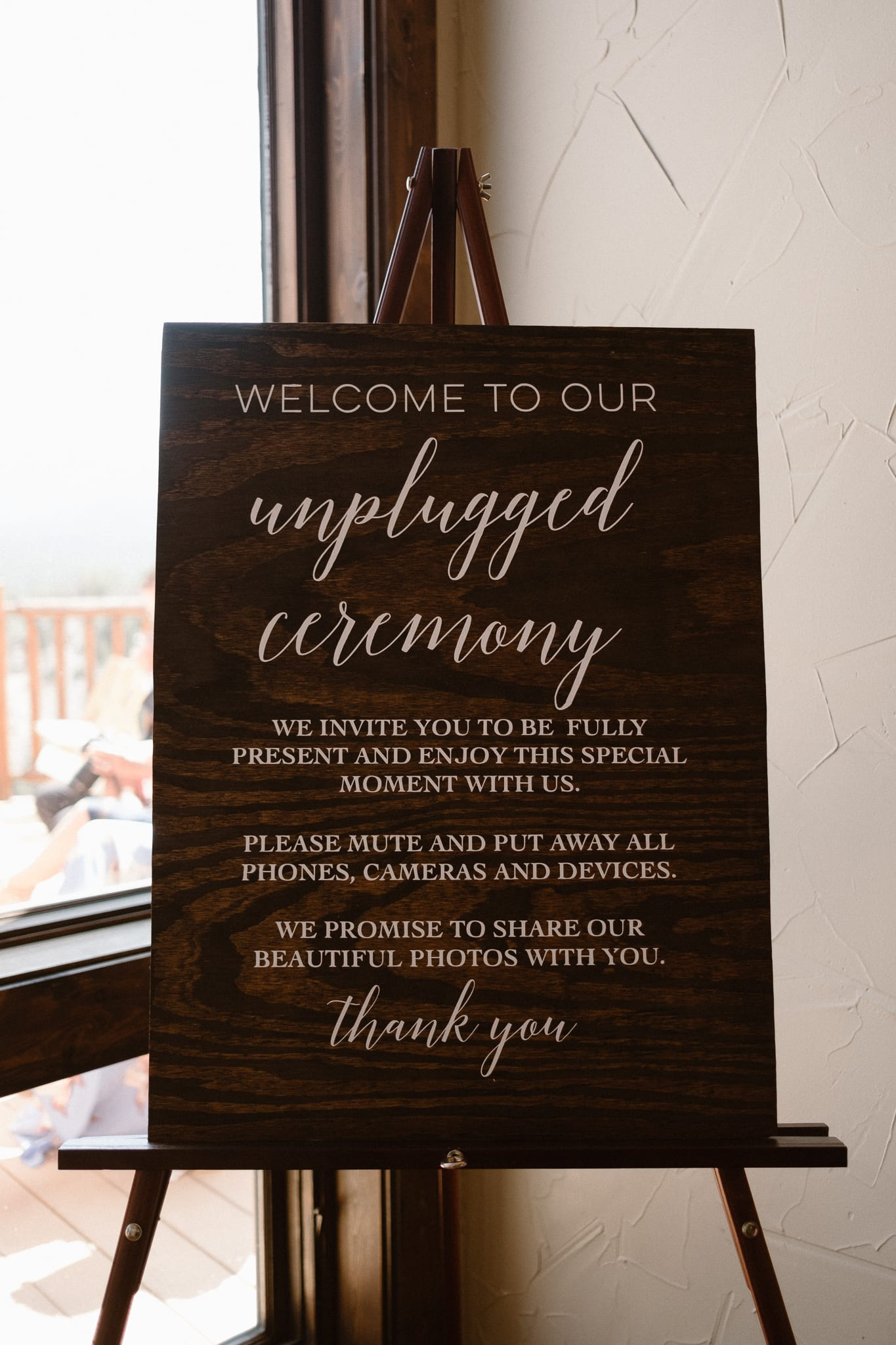 Unplugged wedding ceremony sign.