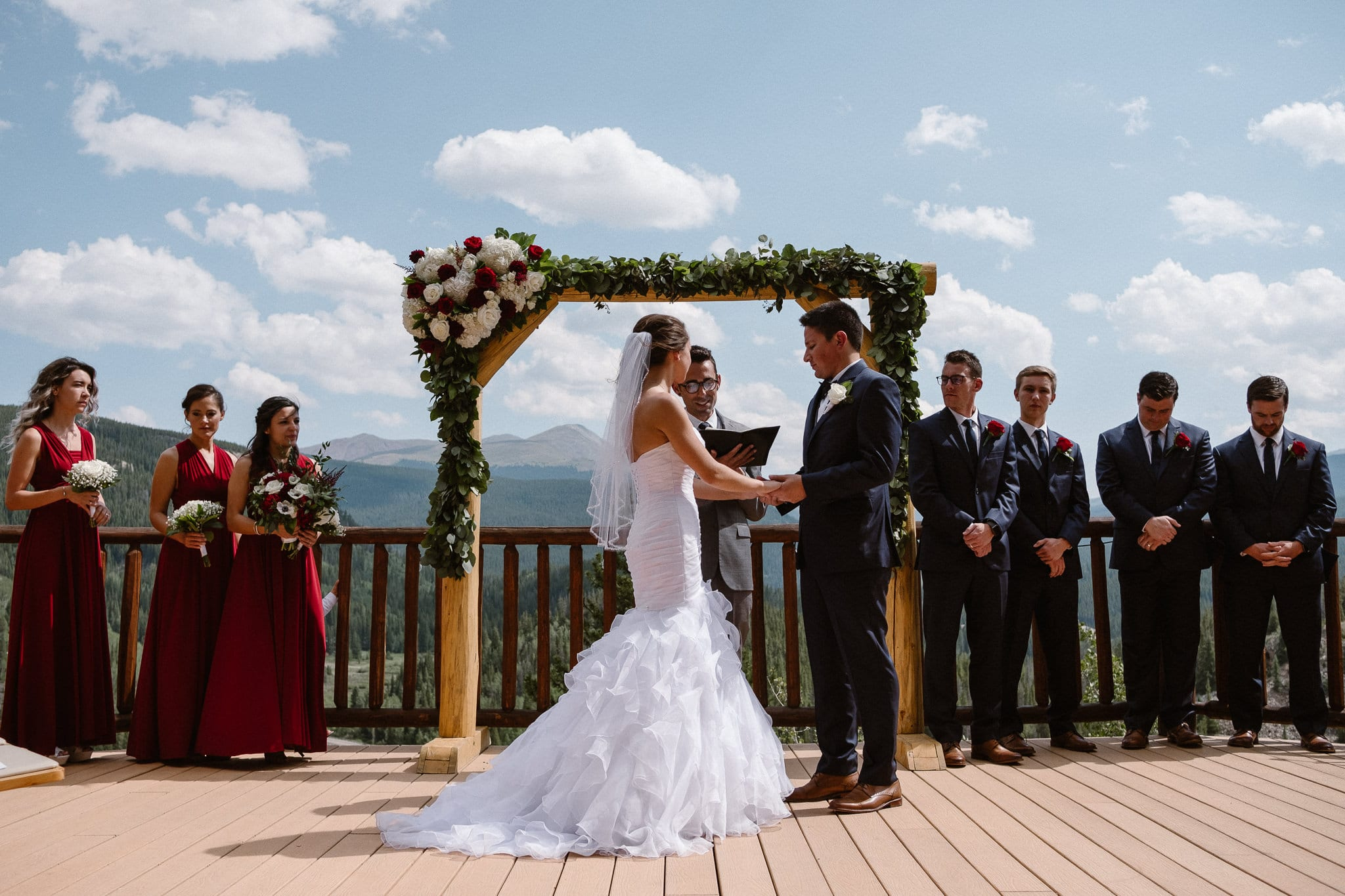 Lodge at Breckenridge Wedding Photographer, Colorado mountain wedding photographer, intimate wedding ceremony on deck with mountain views, vow exchange