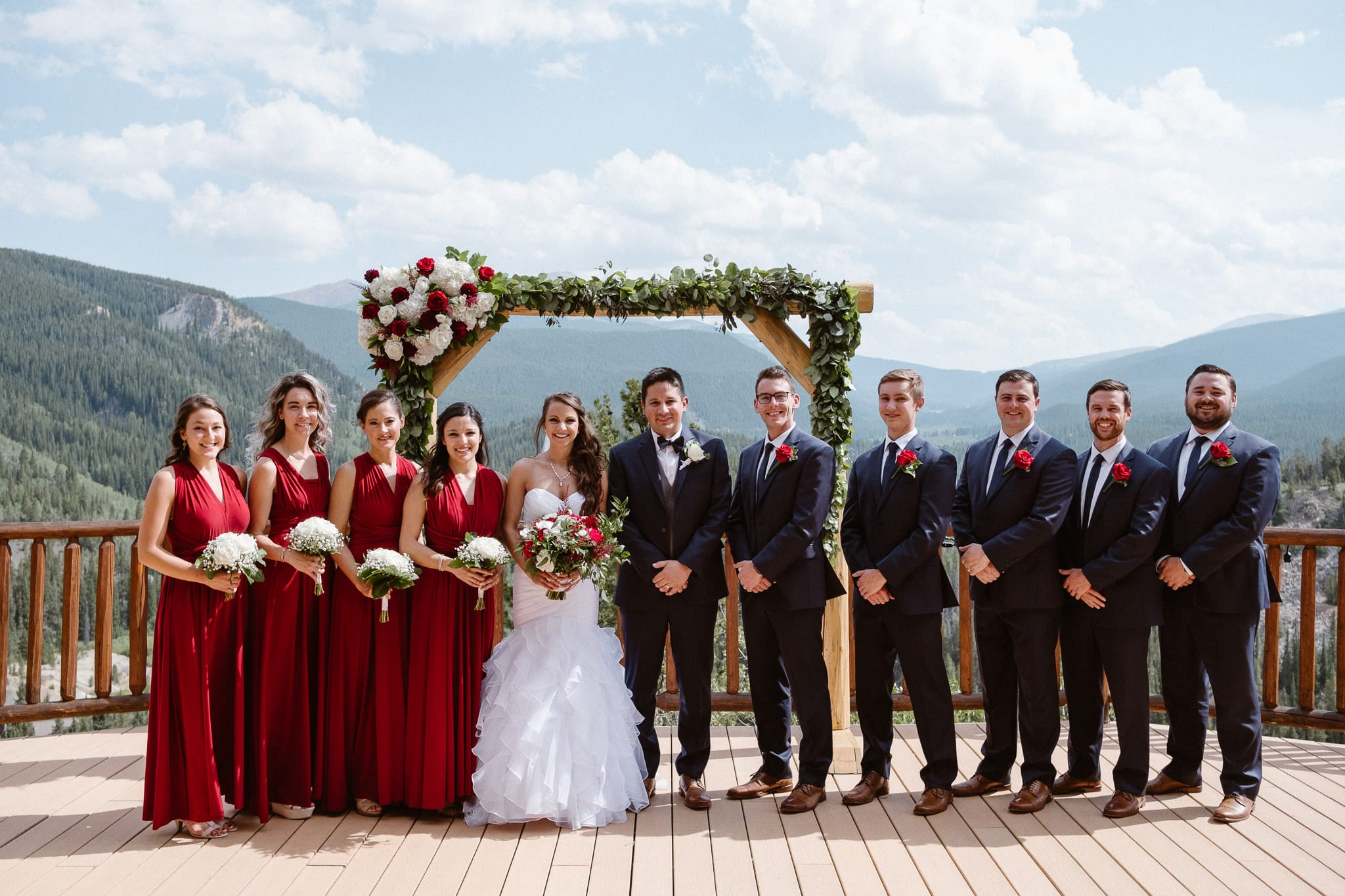 Lodge at Breckenridge Wedding Photographer, Colorado mountain wedding photographer, bride and groom with wedding party, dark red bridesmaid dresses, dark suits with red boutonnieres