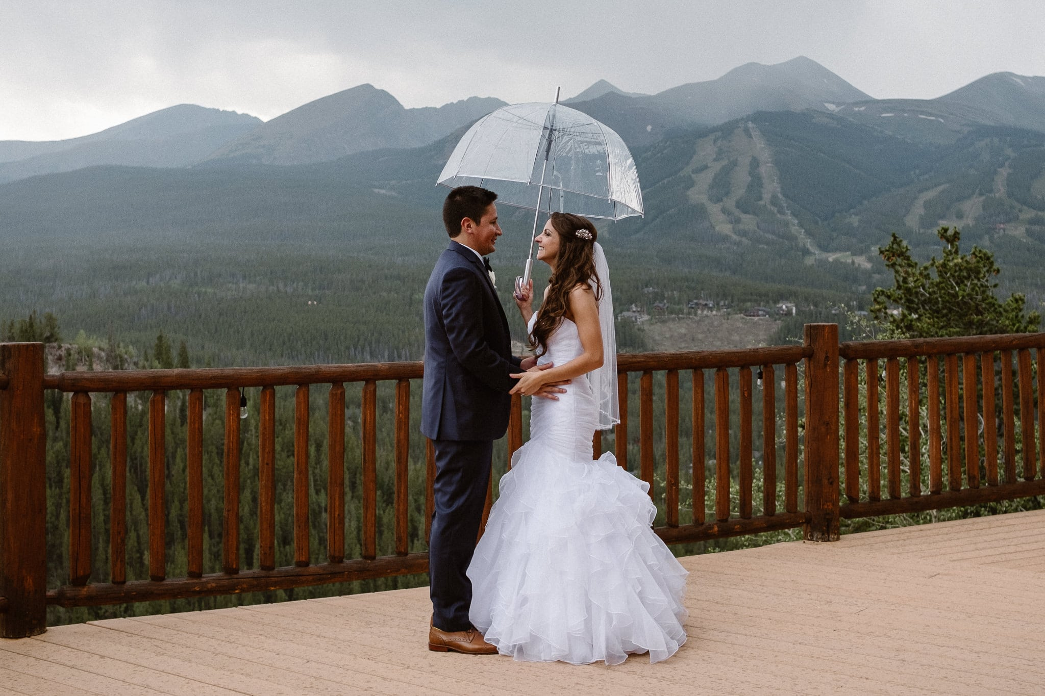 Lodge at Breckenridge Wedding Photographer, Colorado mountain wedding photographer, bride and groom portraits in rain with clear umbrella