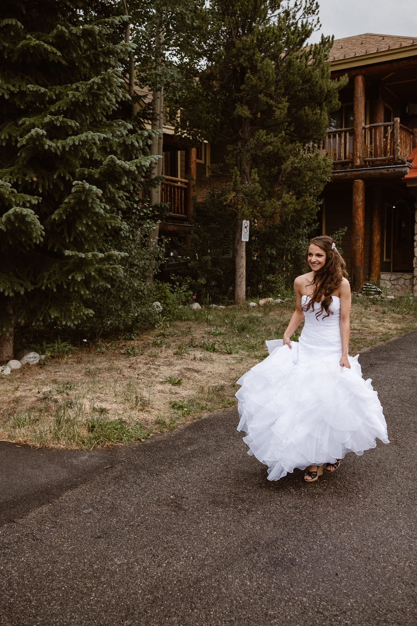 Bride walking up to groom at their first look at The Lodge at Breckenridge wedding.
