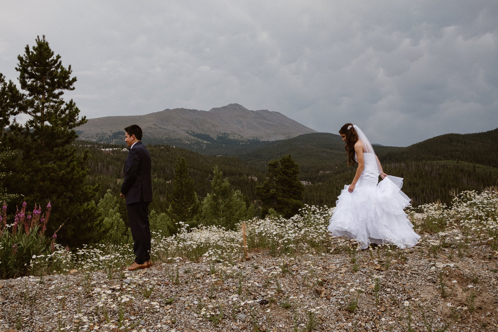 Lodge at Breckenridge Wedding Photographer, Colorado mountain wedding photographer, intimate wedding, bride walking to first look, mermaid wedding dress