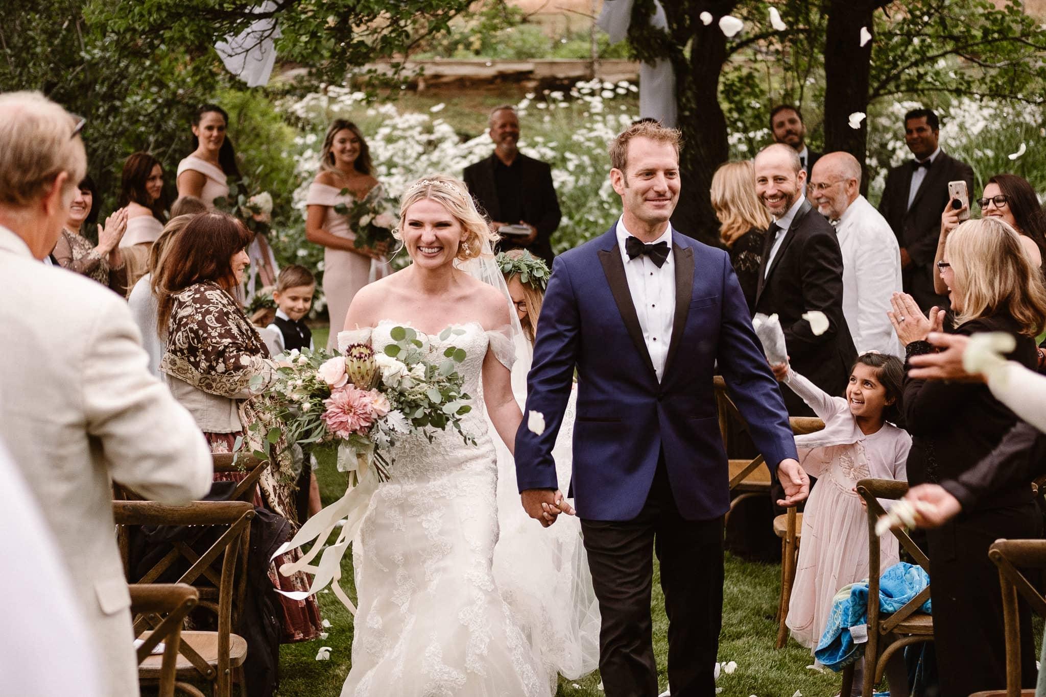Aspen ranch wedding photographer, private ranch luxury wedding Colorado, bride and groom recessional