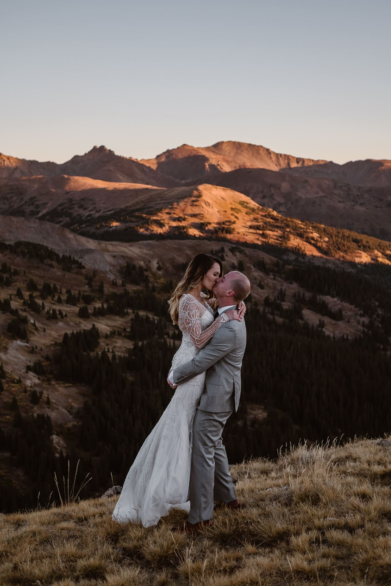Sunrise hiking elopement, Colorado elopement photographer, mountain elopement, Loveland Pass, Colorado intimate wedding photographer, Summit County wedding photographer, bride and groom hiking, alpenglow wedding photos