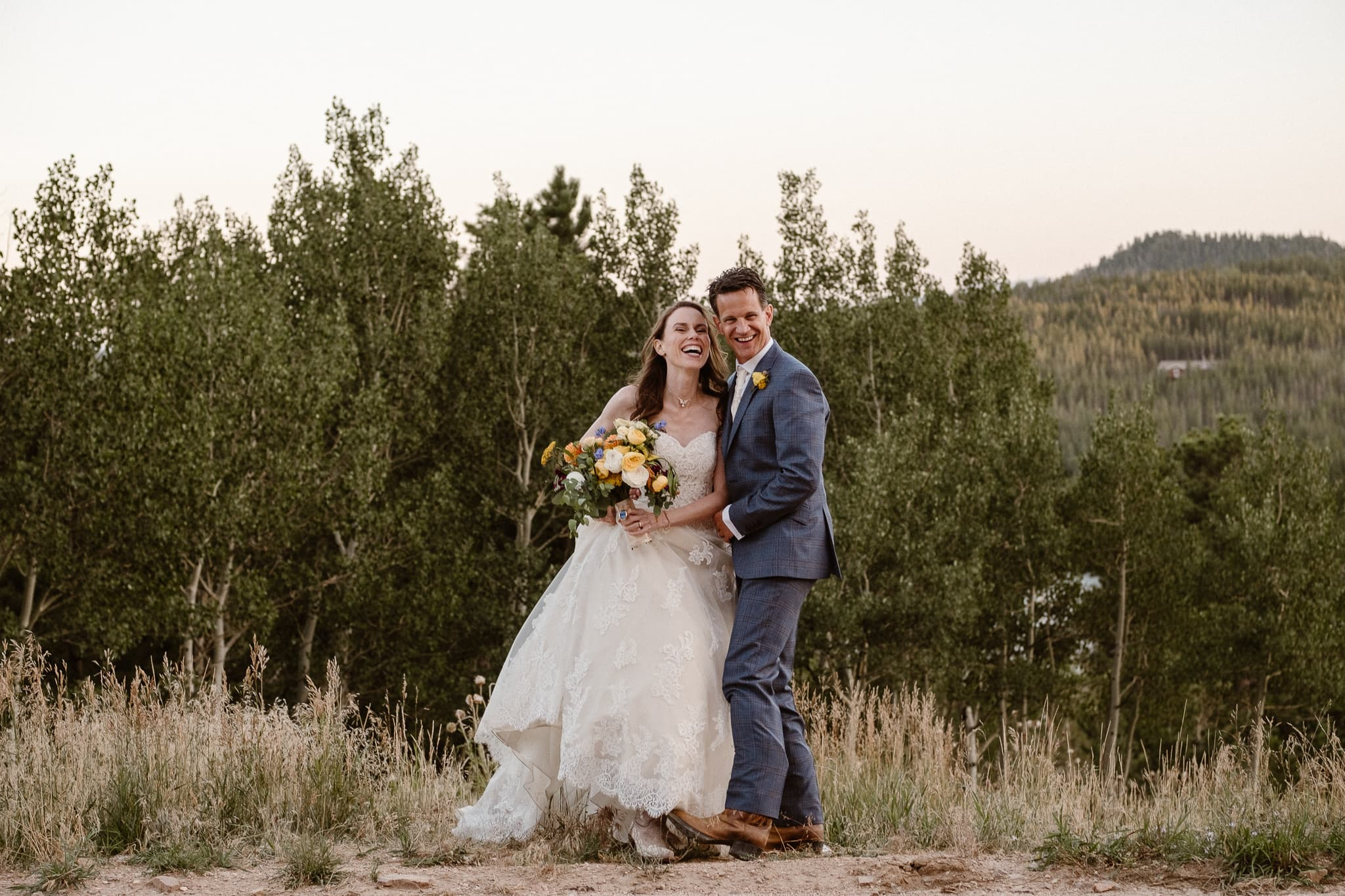 Red Feather Lakes elopement photographer, Colorado intimate cabin wedding, bride portrait with bouquet by Lace & Lilies
