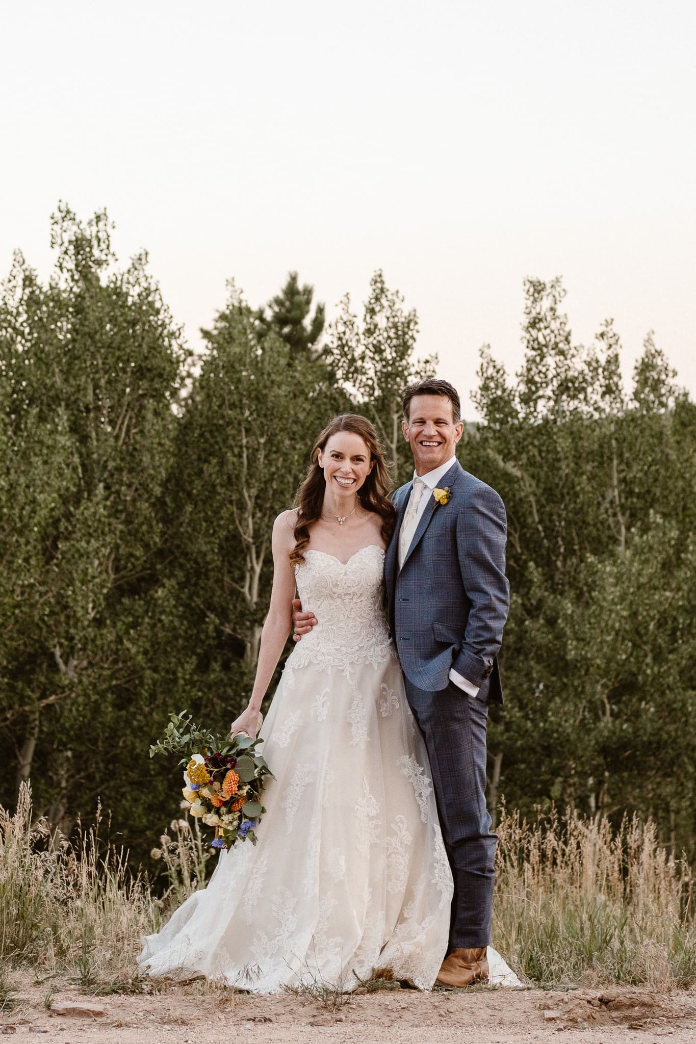 Red Feather Lakes elopement photographer, Colorado intimate cabin wedding, bride and groom portrait with bouquet by Lace & Lilies