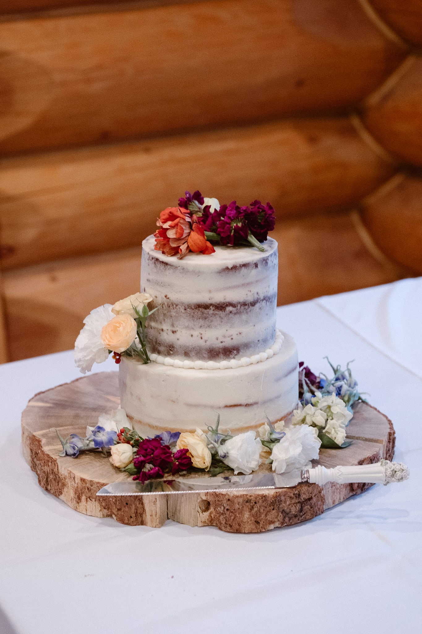 Red Feather Lakes elopement photographer, Colorado intimate cabin wedding, naked frosting wedding cake with flowers