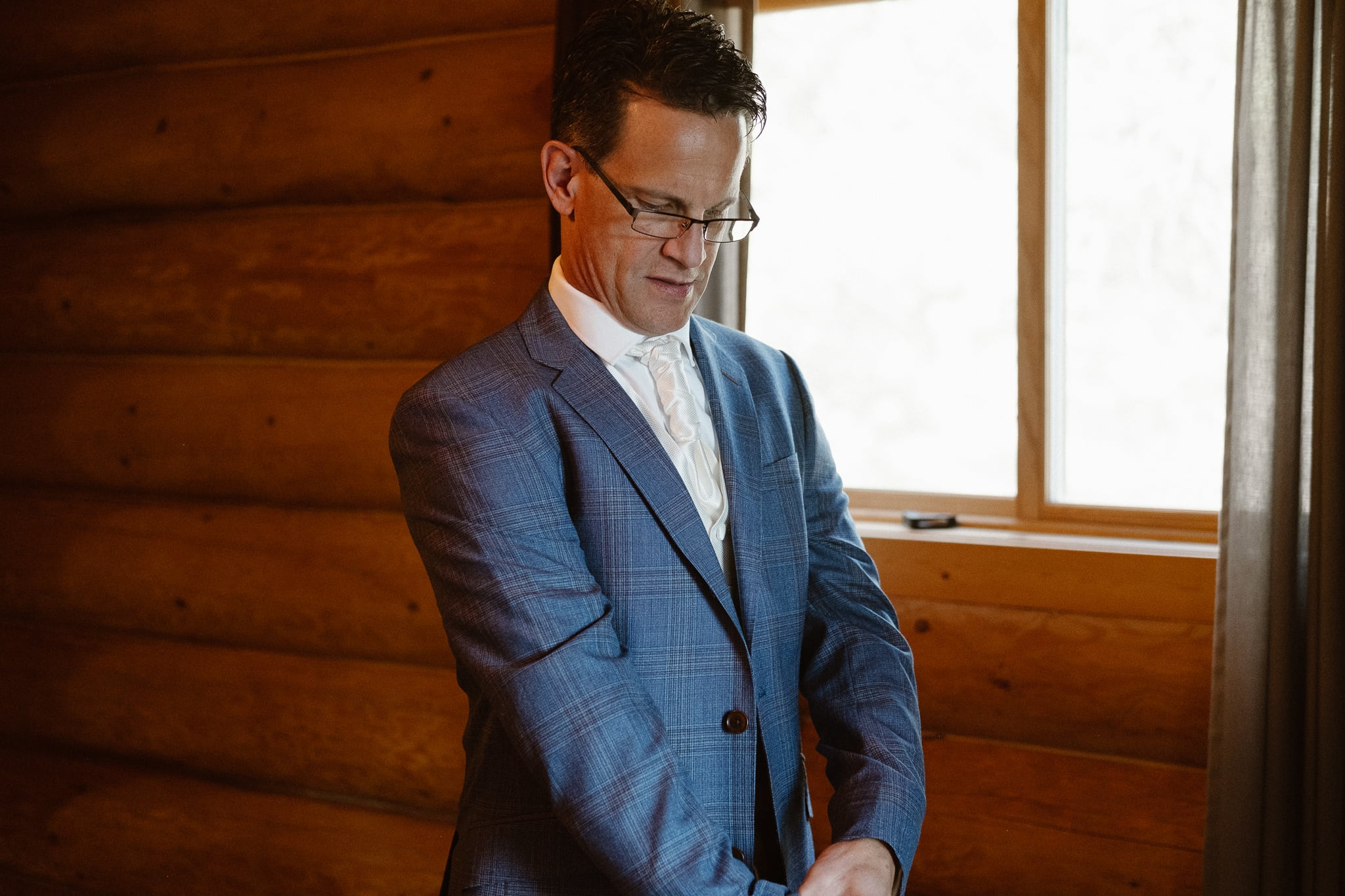 Red Feather Lakes elopement photographer, Colorado intimate cabin wedding, groom getting ready