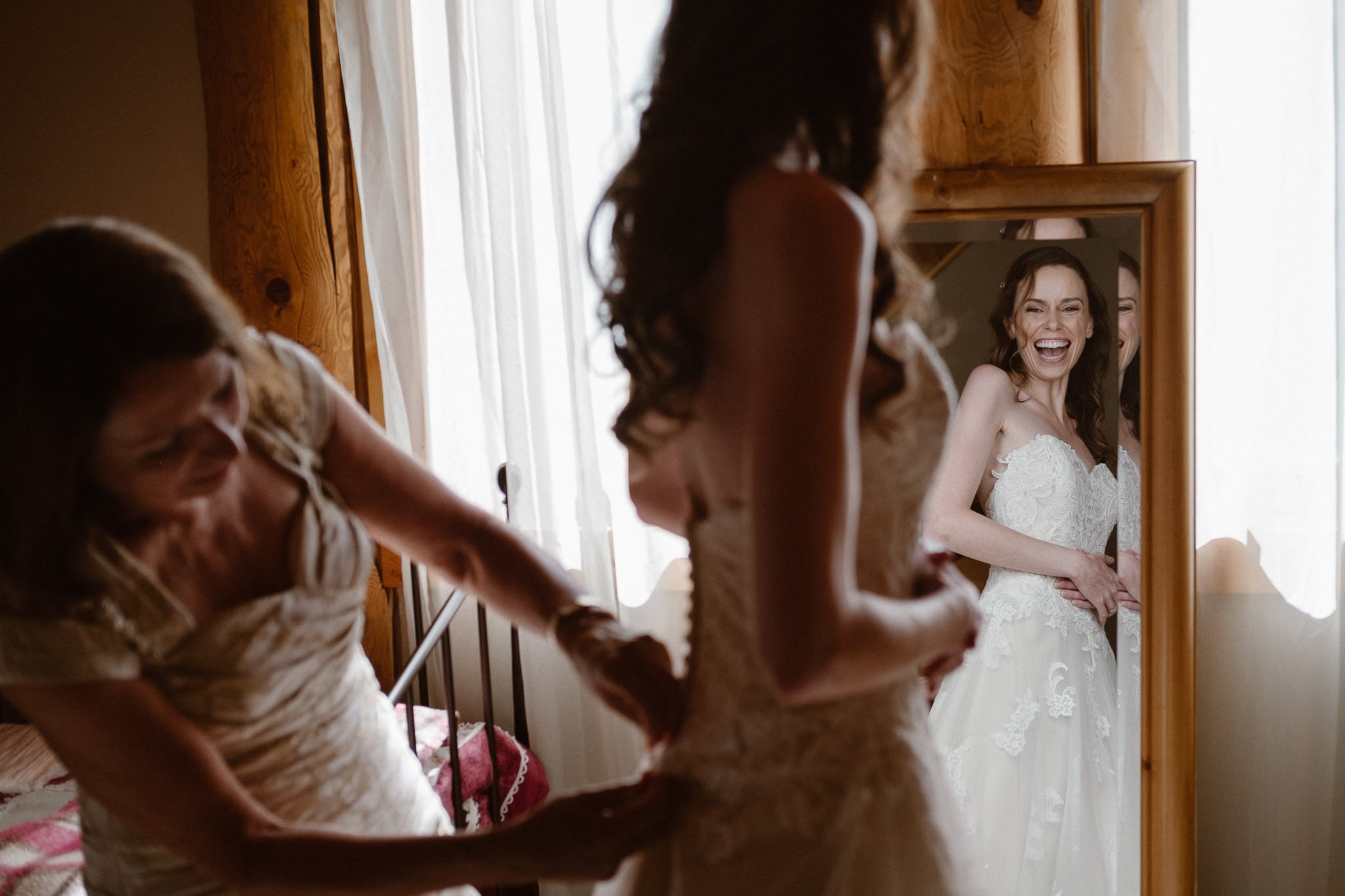 Red Feather Lakes elopement photographer, Colorado intimate cabin wedding, bride getting ready in cabin